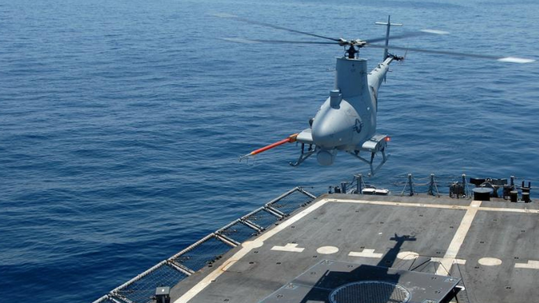 UNDATED: A Fire Scout unmanned helicopter lands aboard the USS McInerney during developmental testing.