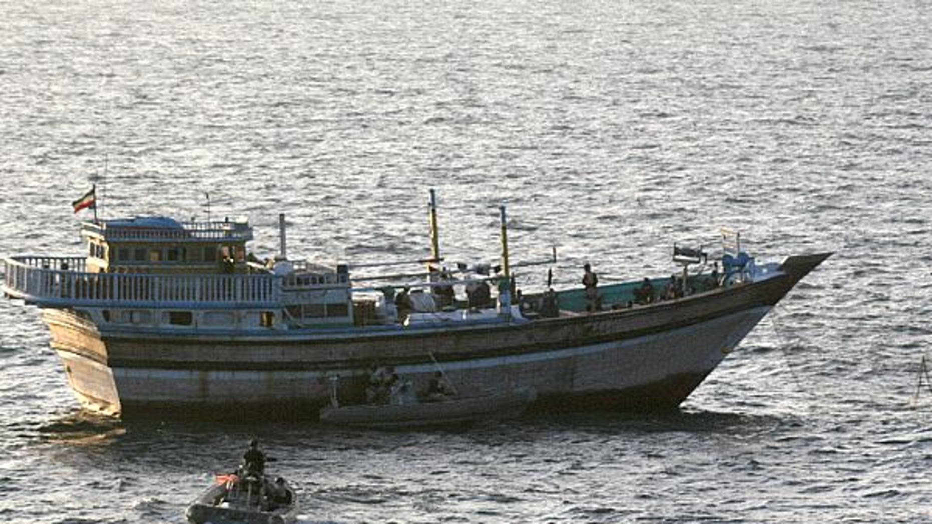 Jan. 5, 2012: A Sailor aboard a safety boat observes a visit, board, search and seizure team, assigned to the guided-missile destroyer USS Kidd (DDG 100), board the Iranian-flagged fishing dhow Al Molai.