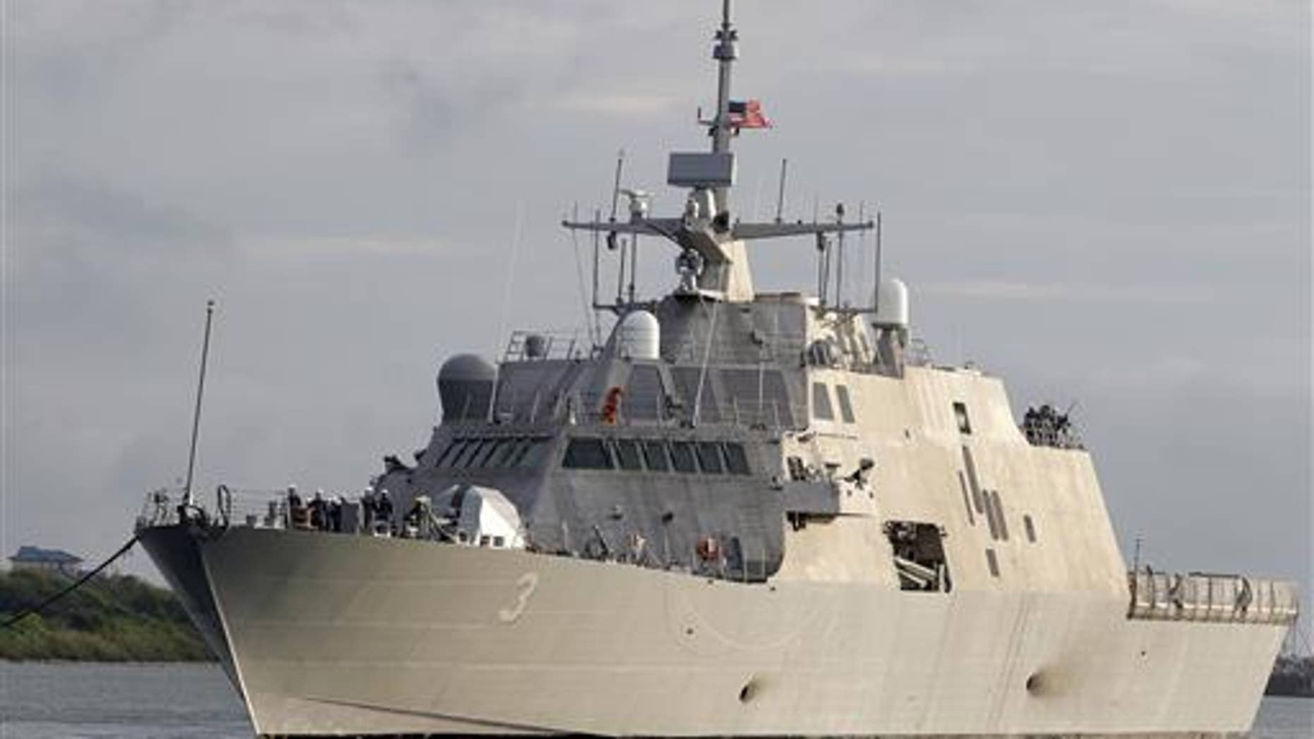In this Sept. 17, 2012, file photo, the littoral combat ship USS Forth Worth arrives at the port of Galveston, Texas, to prepare for its formal commissioning ceremony.