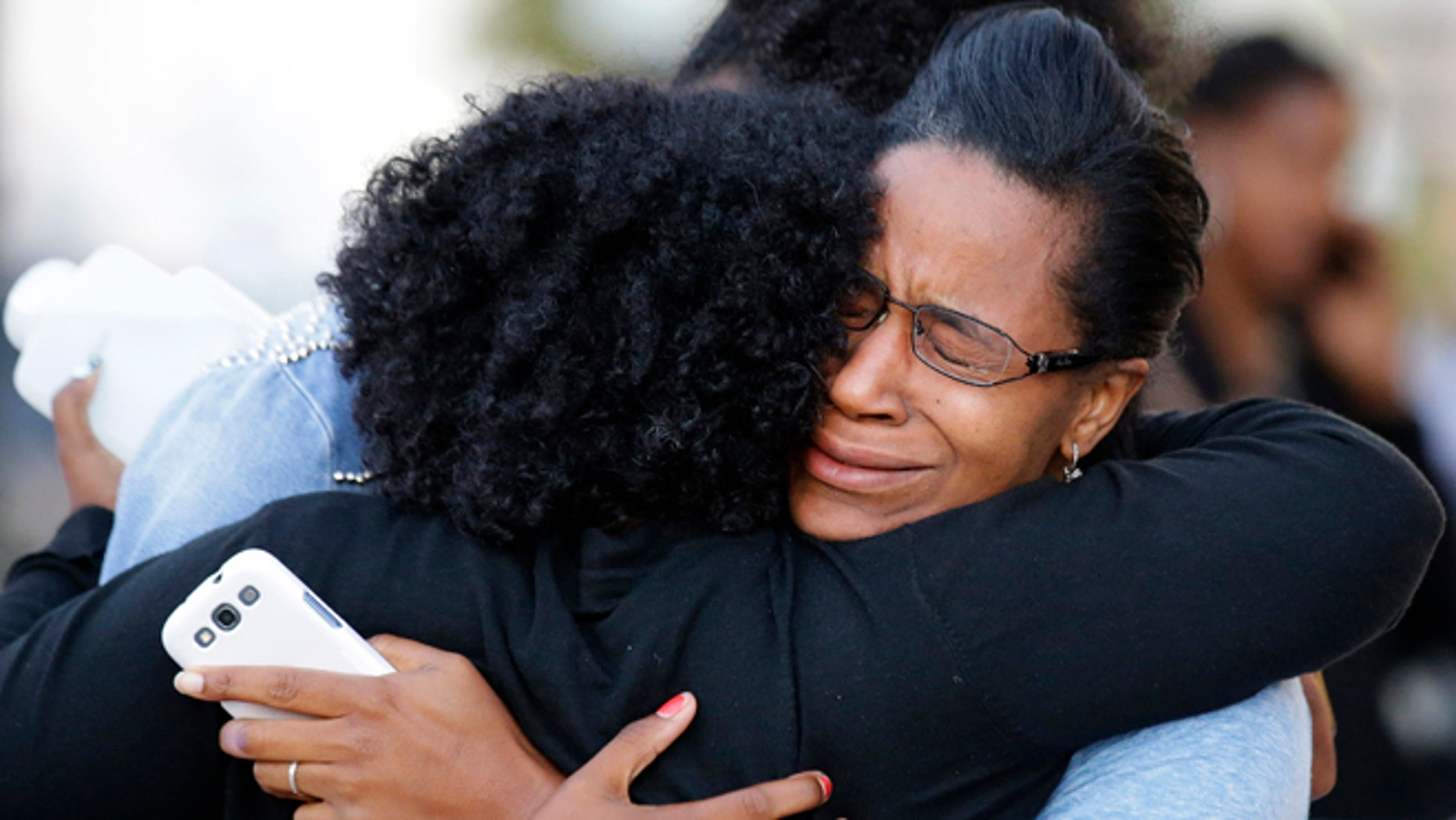 Sept. 16, 2013: Three women embrace near Nationals Park where family members waited to greet loved ones that were at the Washington Navy Yard in Washington. At least one gunman launched an attack inside the Washington Navy Yard, spraying gunfire on office workers in the cafeteria and in the hallways at the heavily secured military installation in the heart of the nation's capital, authorities said. (AP/Alex Brandon)