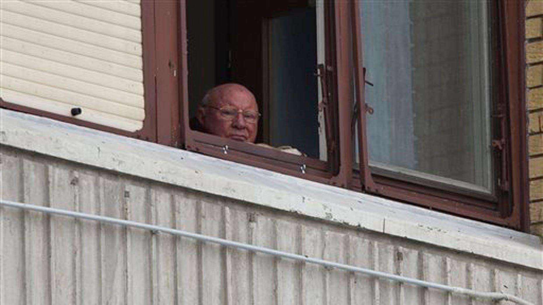 July 28, 2014: Jakob Denzinger looks from his apartment window in Osijek, eastern Croatia.
