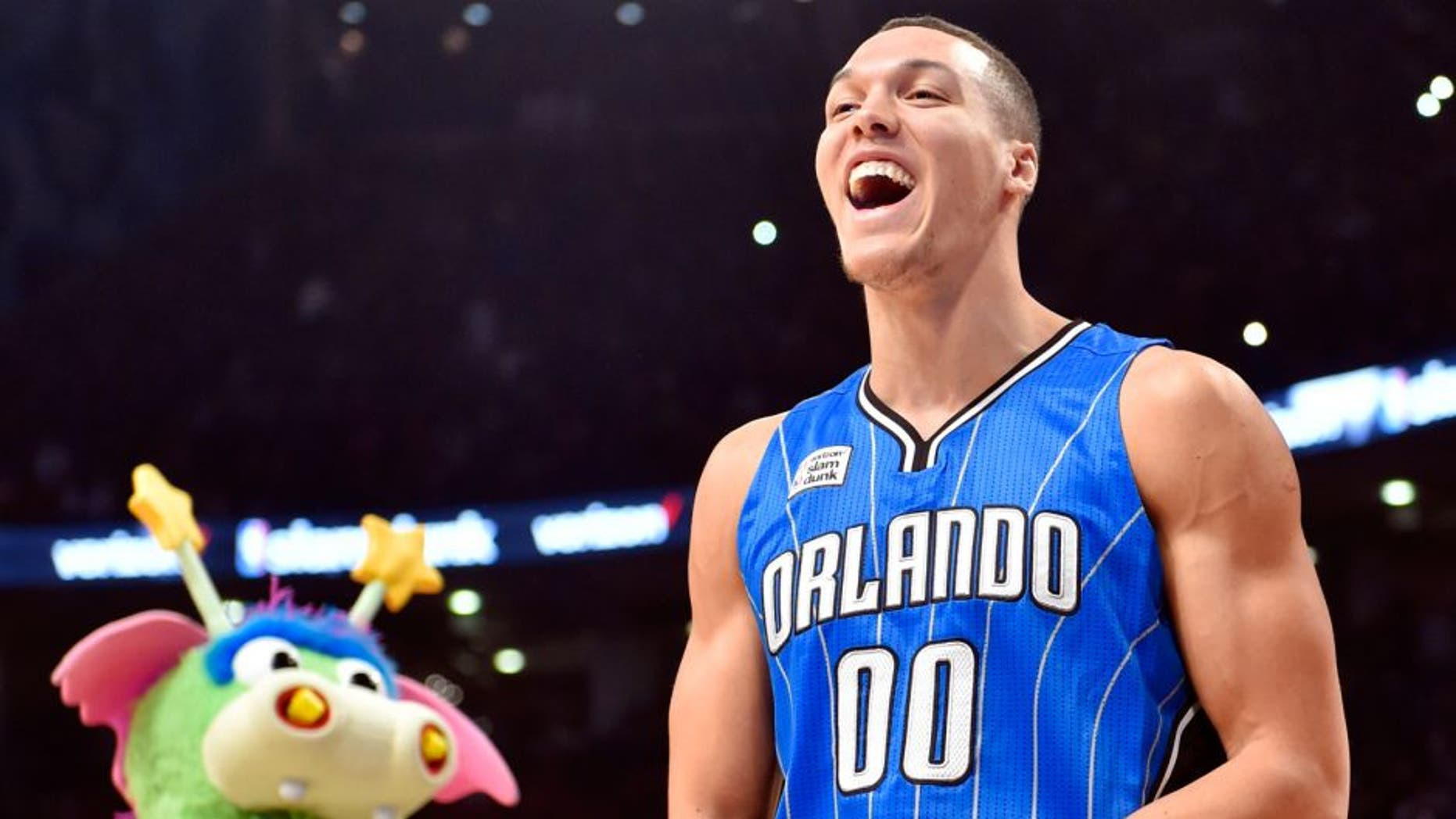 Feb 13, 2016; Toronto, Ontario, Canada; Orlando Magic forward Aaron Gordon reacts after a successful dunk over the Magic mascot during the dunk contest during the NBA All Star Saturday Night at Air Canada Centre. Mandatory Credit: Bob Donnan-USA TODAY Sports