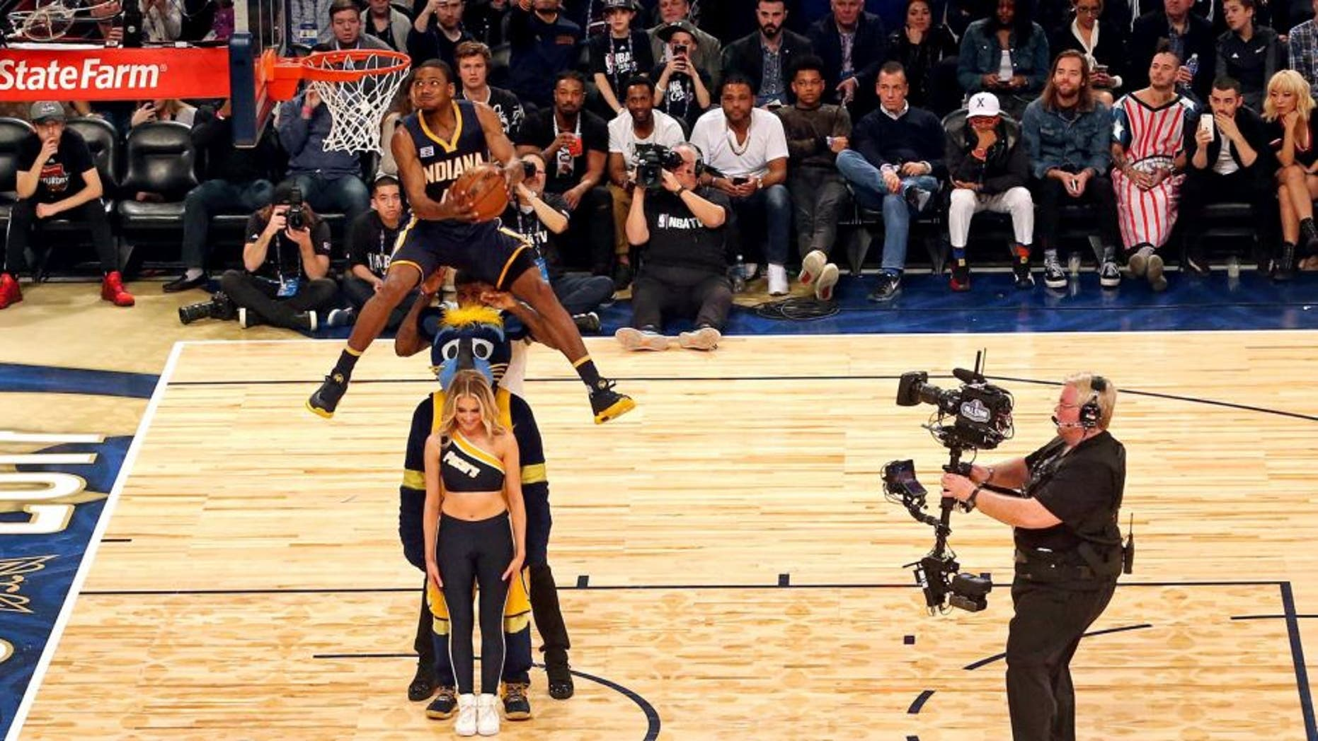 Feb 18, 2017; New Orleans, LA, USA; Indiana Pacers forward Glenn Robinson III (40) makes the winning dunk in the slam dunk contest during NBA All-Star Saturday Night at Smoothie King Center. Mandatory Credit: Bob Donnan-USA TODAY Sports