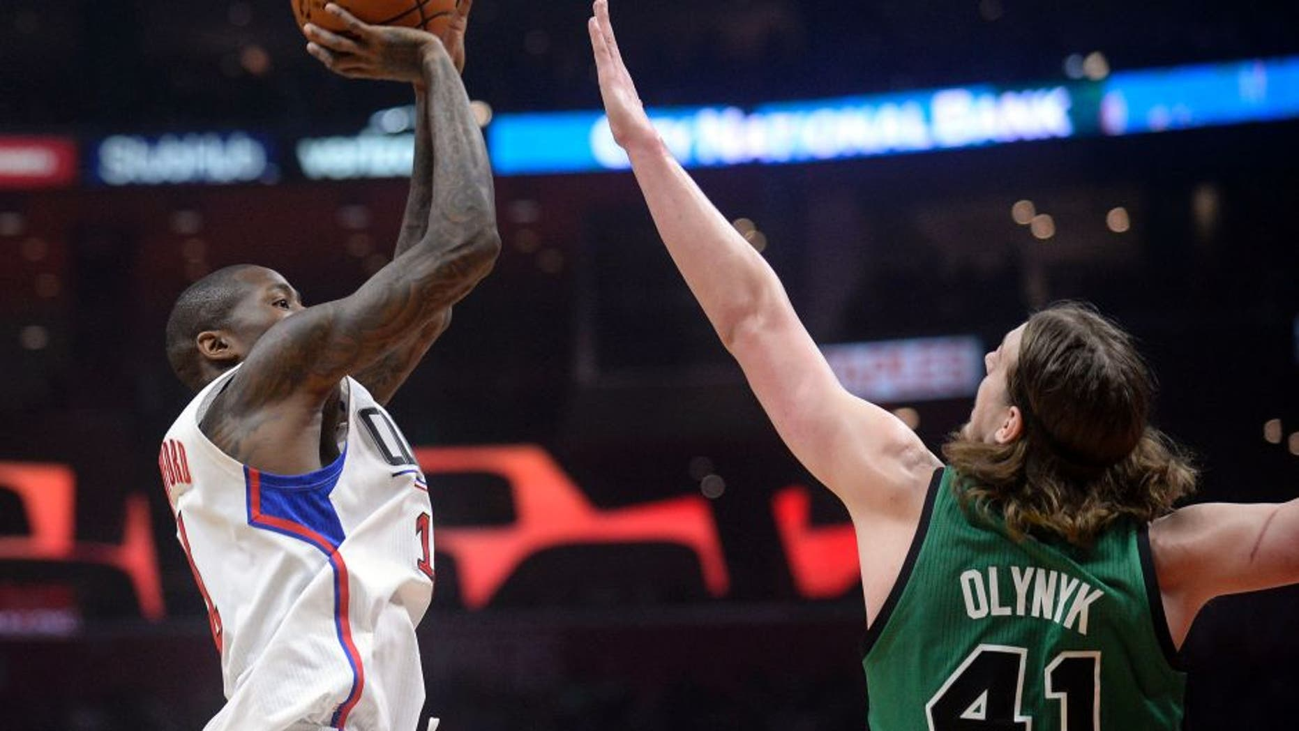 March 6, 2017; Los Angeles, CA, USA; Los Angeles Clippers guard Jamal Crawford (11) shoots against the defense of Boston Celtics center Kelly Olynyk (41) during the first half at Staples Center. Mandatory Credit: Gary A. Vasquez-USA TODAY Sports