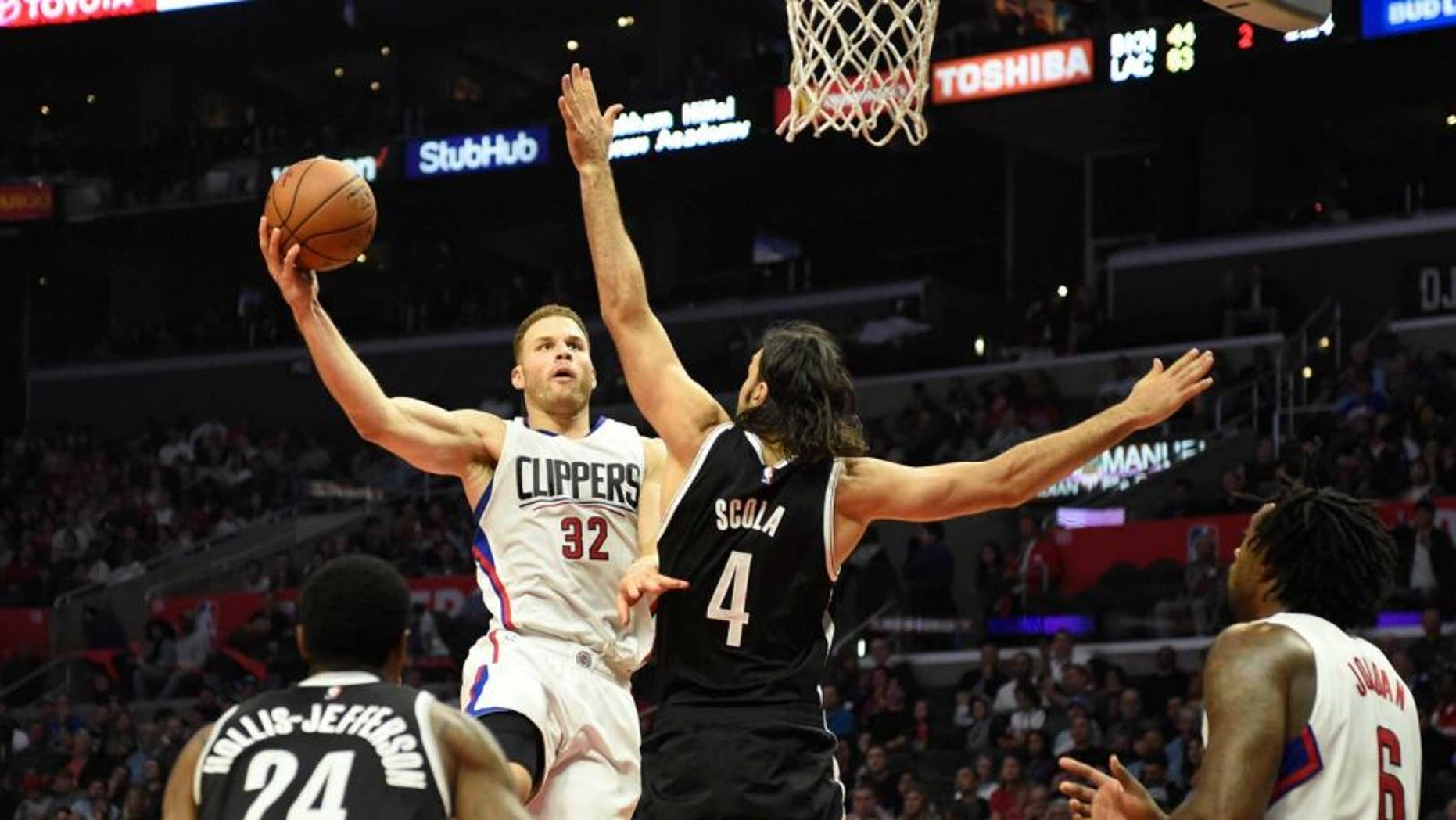 Nov 14, 2016; Los Angeles, CA, USA; Los Angeles Clippers forward Blake Griffin (32) shoots against Brooklyn Nets forward Luis Scola (4) in the first half of a NBA basketball game at Staples Center. Mandatory Credit: Richard Mackson-USA TODAY Sports