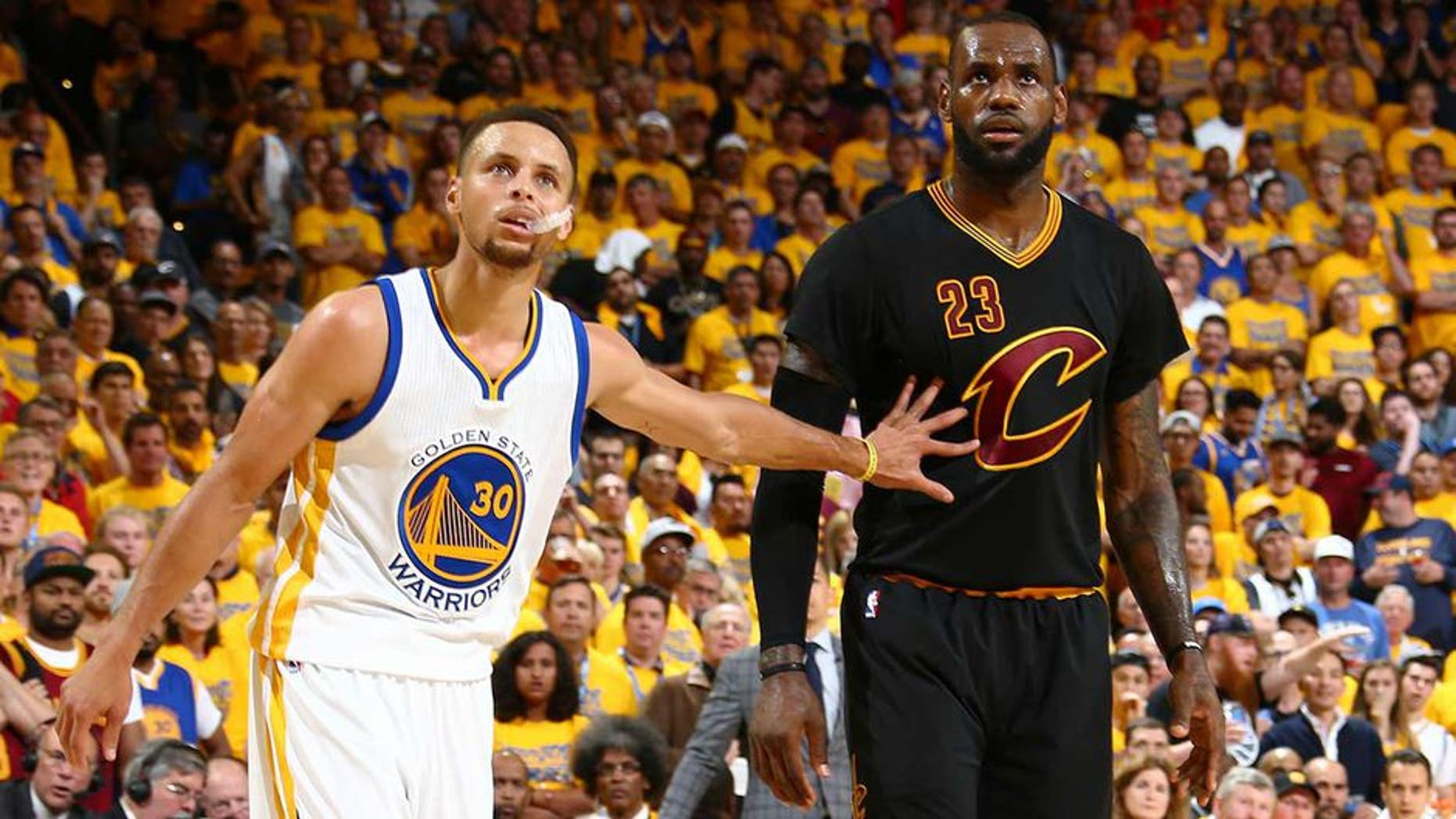 OAKLAND, CA - JUNE 19: Stephen Curry #30 of the Golden State Warriors and LeBron James #23 of the Cleveland Cavaliers during the game in Game Seven of the 2016 NBA Finals on June 19, 2016 at Oracle Arena in Oakland, California. NOTE TO USER: User expressly acknowledges and agrees that, by downloading and or using this photograph, user is consenting to the terms and conditions of Getty Images License Agreement. Mandatory Copyright Notice: Copyright 2016 NBAE (Photo by Nathaniel S. Butler/NBAE via Getty Images)