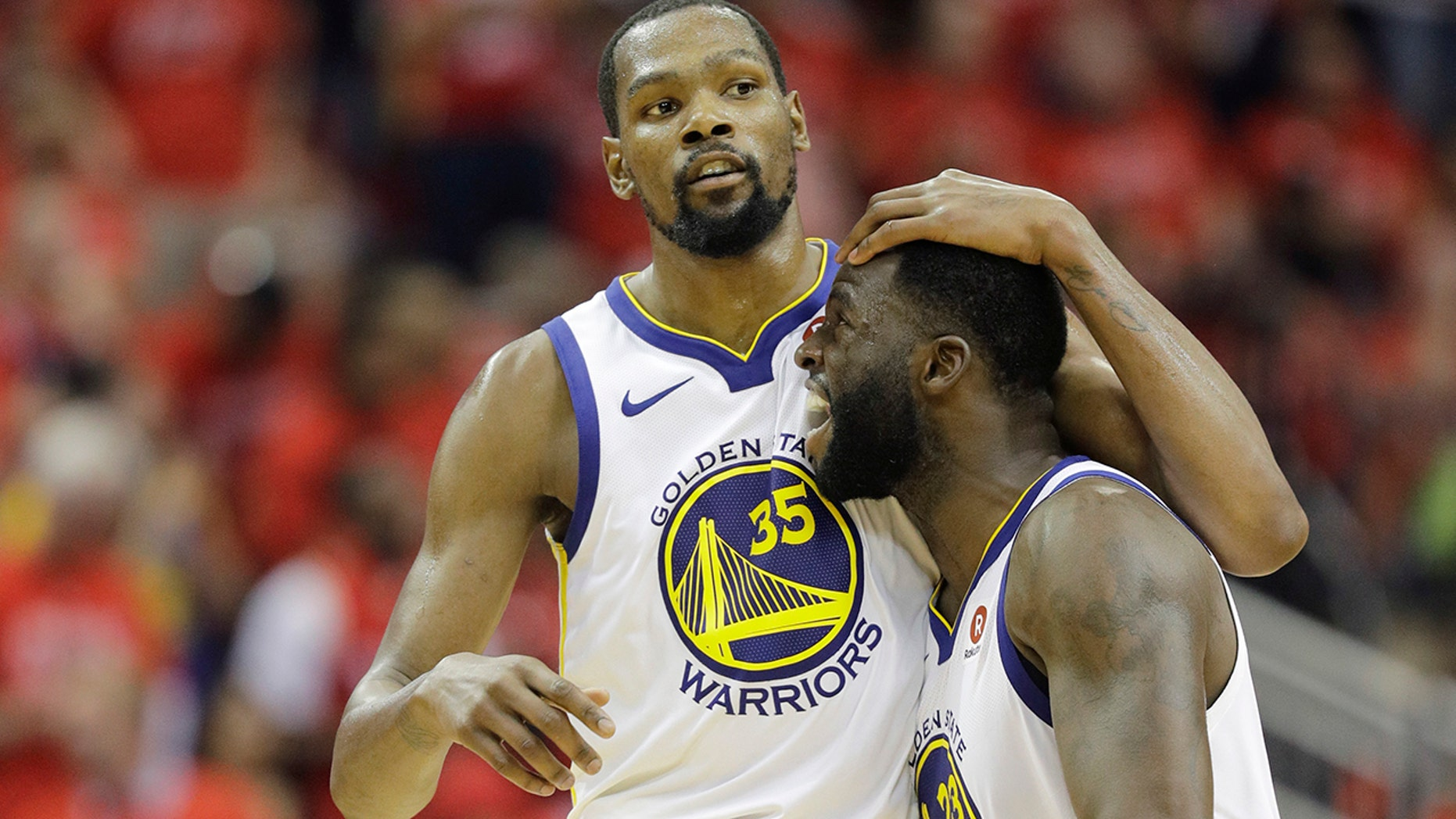 Golden State Warriors forward Kevin Durant (35) celebrates with teammate Draymond Green (23) during the second half in Game 7 of the NBA basketball Western Conference finals against the Houston Rockets, Monday, May 28, 2018, in Houston.