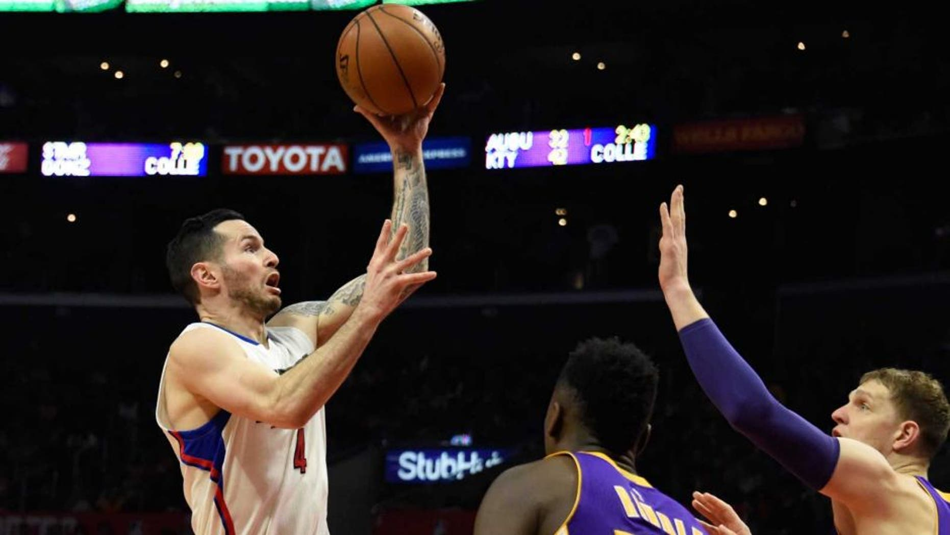 Jan 14, 2017; Los Angeles, CA, USA; LA Clippers guard J.J. Redick (4) shoots against Los Angeles Lakers forward Julius Randle (30) during the NBA game at the Staples Center. Mandatory Credit: Richard Mackson-USA TODAY Sports