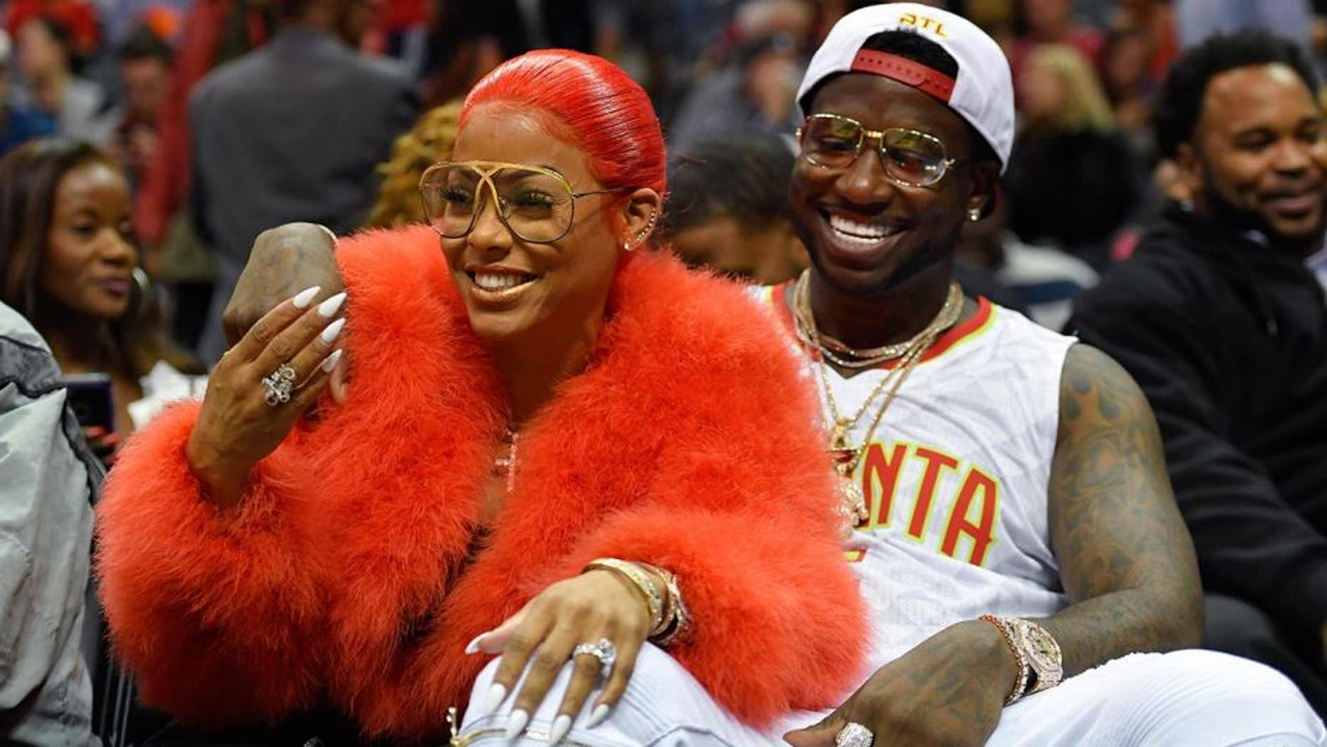 Nov 22, 2016; Atlanta, GA, USA; Recording artist Gucci Mane reacts with Keyshia Ka'oir after being engaged during a time out during the New Orleans Pelicans and Atlanta Hawks game during the second half at Philips Arena. The Pelicans defeated the Hawks 112-96.Mandatory Credit: Dale Zanine-USA TODAY Sports