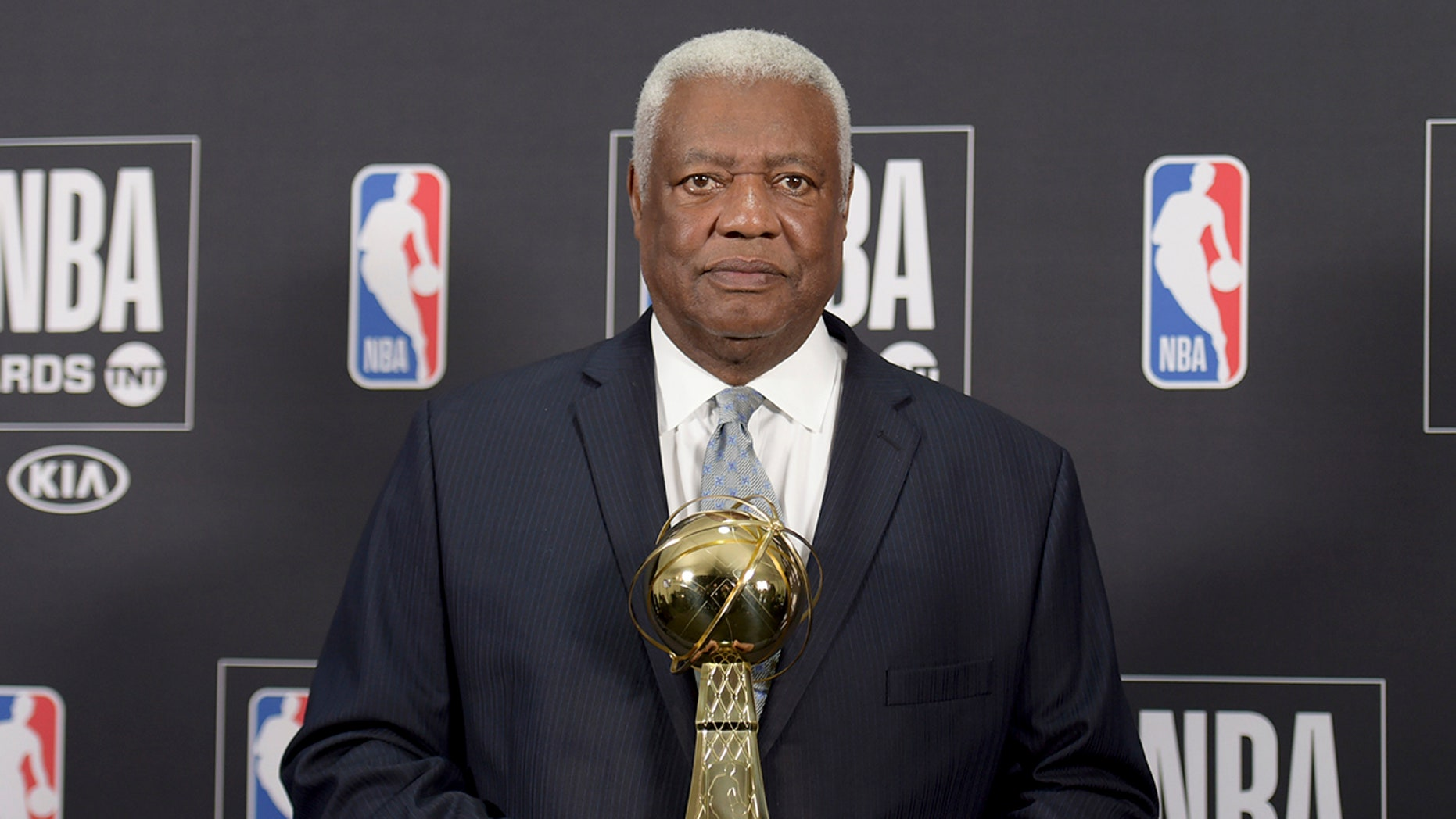 """Oscar """"The Big O"""" Robertson poses in the press room with the lifetime achievement award at the NBA Awards."""