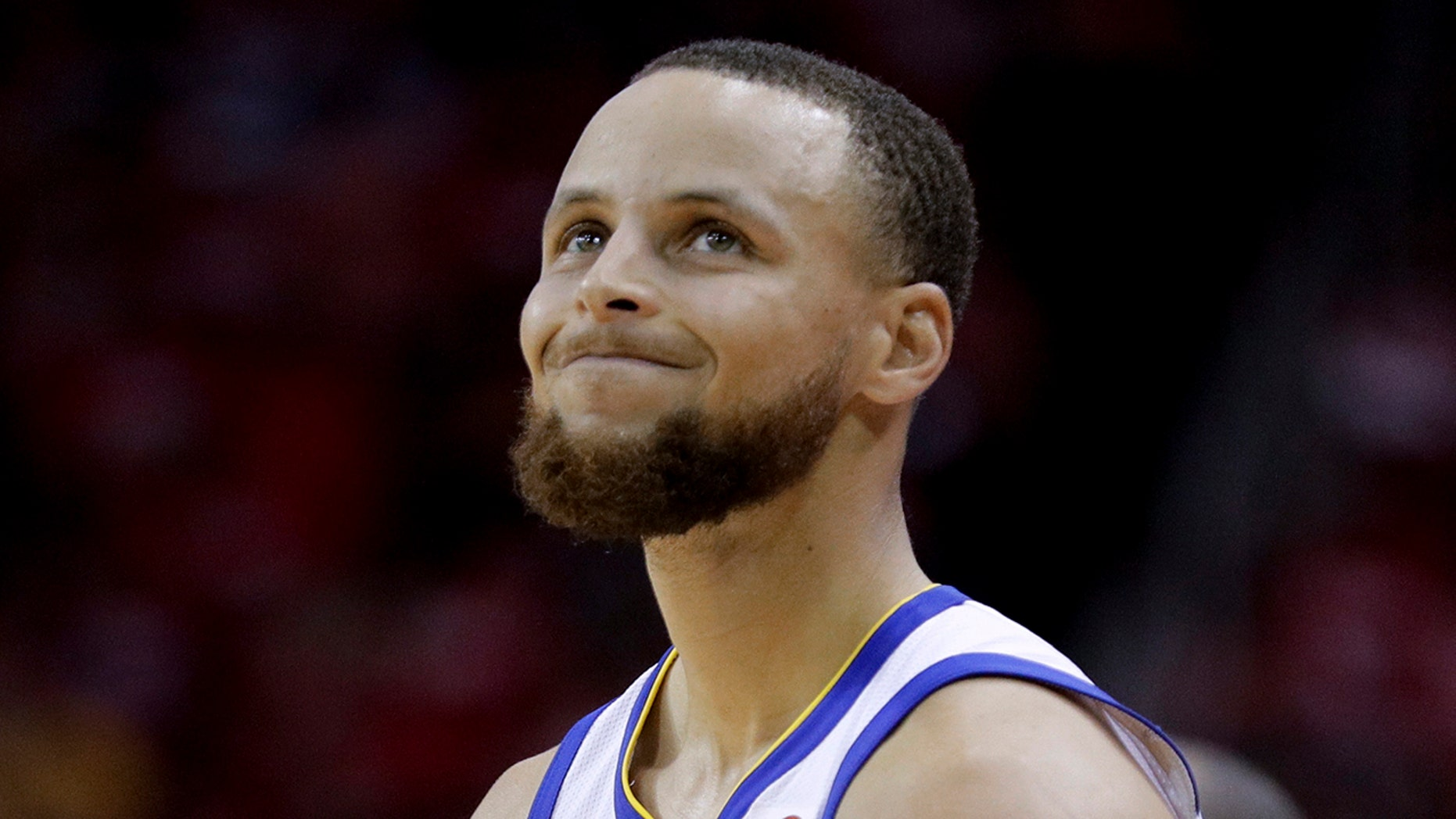 Golden State Warriors guard Stephen Curry reacts after getting called for a foul against the Houston Rockets in Game 5 of the NBA Western Conference finals in Houston, May 24, 2018.