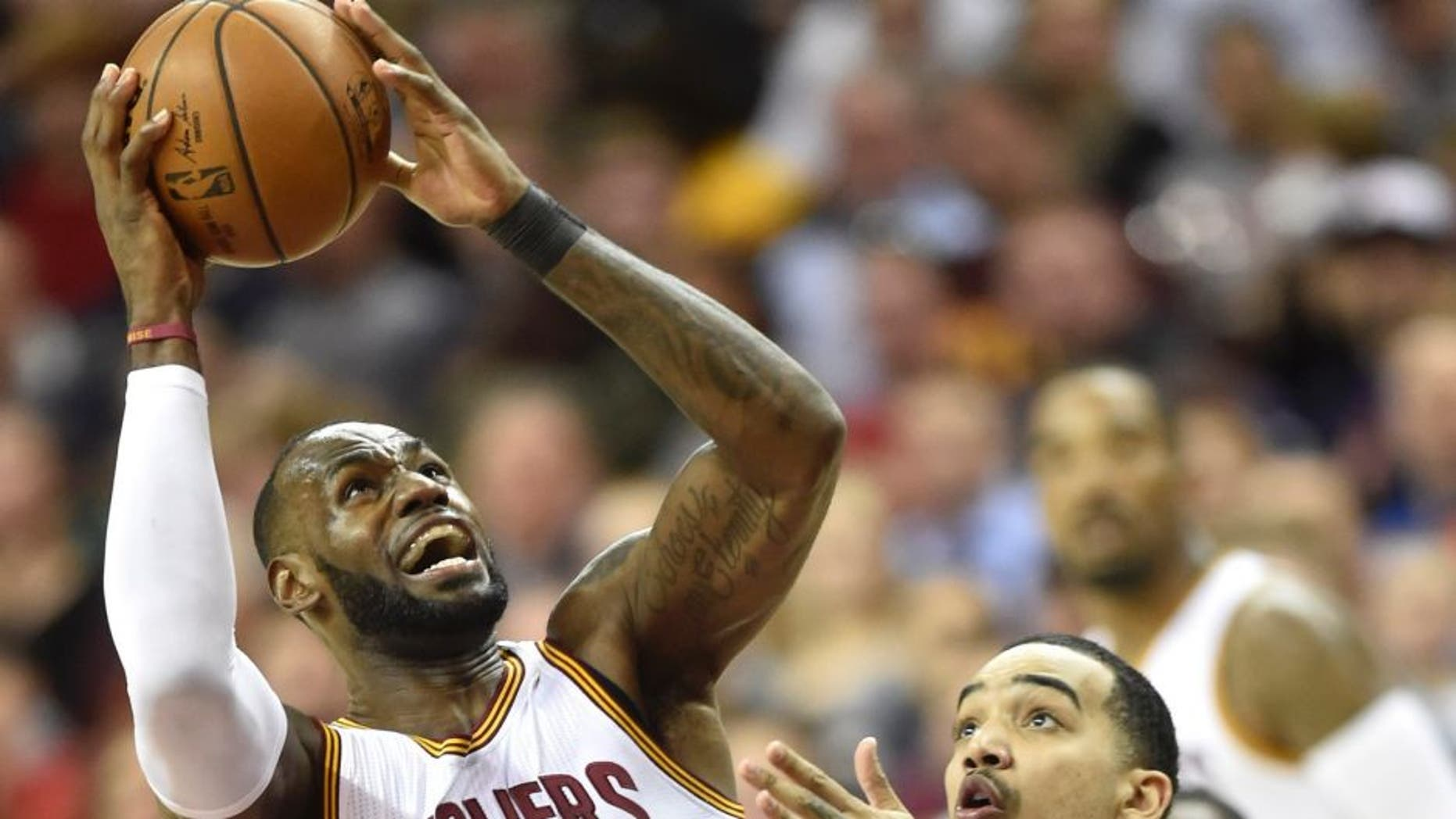 Mar 16, 2017; Cleveland, OH, USA; Cleveland Cavaliers forward LeBron James (23) shoots against Utah Jazz forward Trey Lyles (41) in the second quarter at Quicken Loans Arena. Mandatory Credit: David Richard-USA TODAY Sports