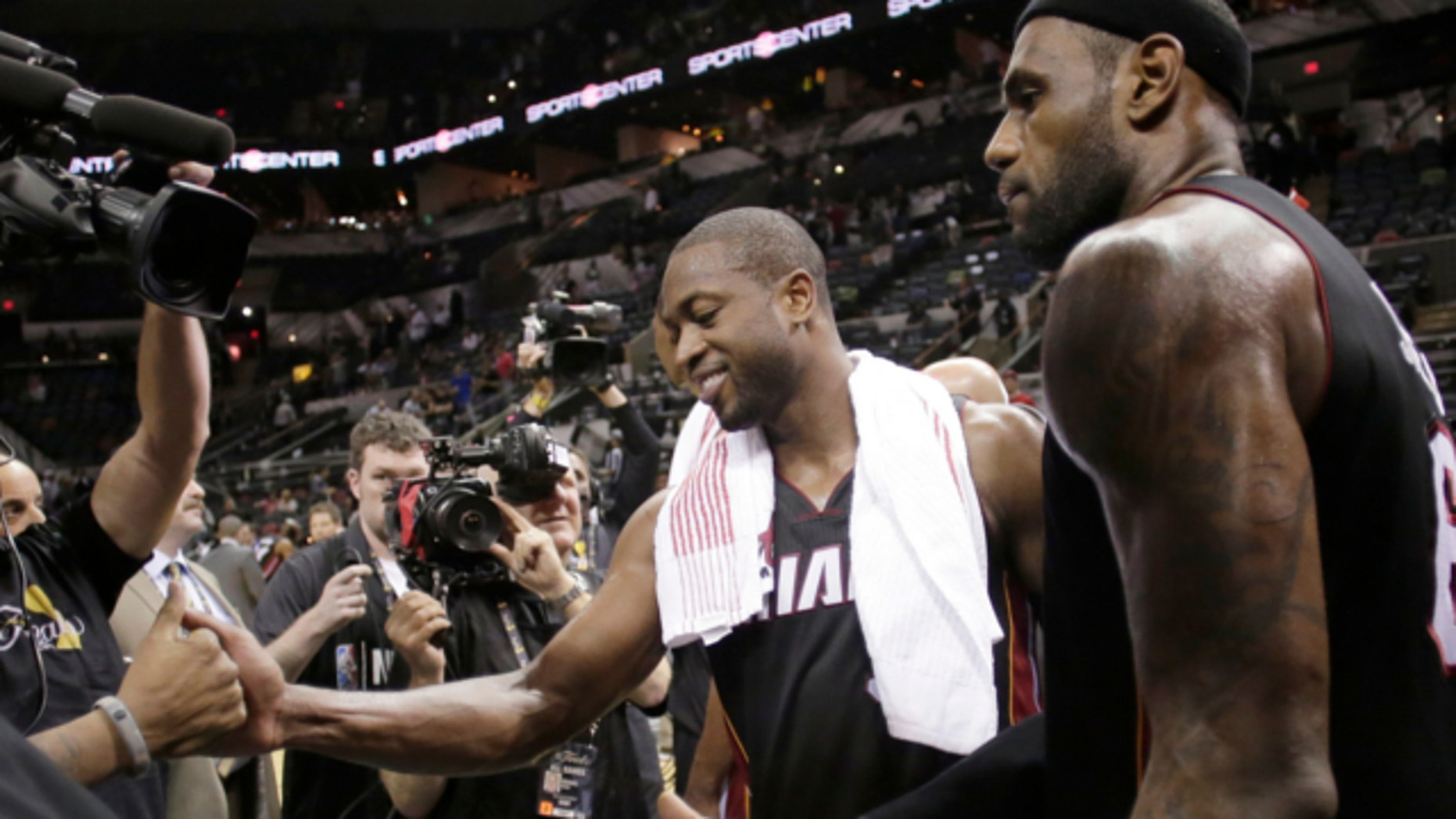 June 13, 2013: Miami Heat's Dwyane Wade, left, and LeBron James leave the floor after beating San Antonio Spurs at Game 4 of the NBA Finals basketball series in San Antonio.