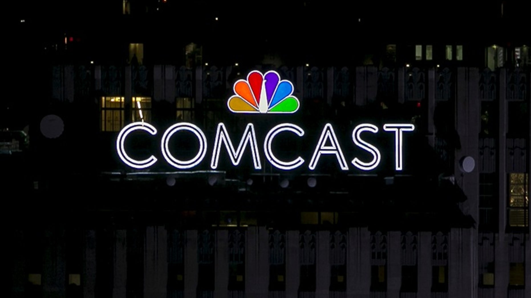 File photo - The NBC and Comcast logo are displayed on top of 30 Rockefeller Plaza in midtown Manhattan in New York July 1, 2015. (REUTERS/Brendan McDermid/File Photo)