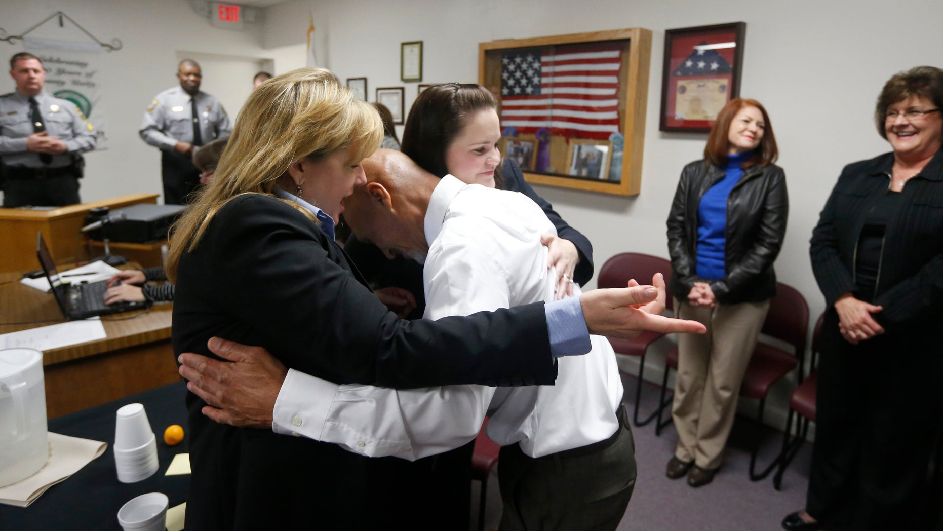 Jan. 23, 2015: Christine Mumma, director of the North Carolina Center on Actual Innocence, left, and Cheryl Sullivan, staff attorney, hug Joseph Sledge after a special session of superior court in Whiteville, N.C.