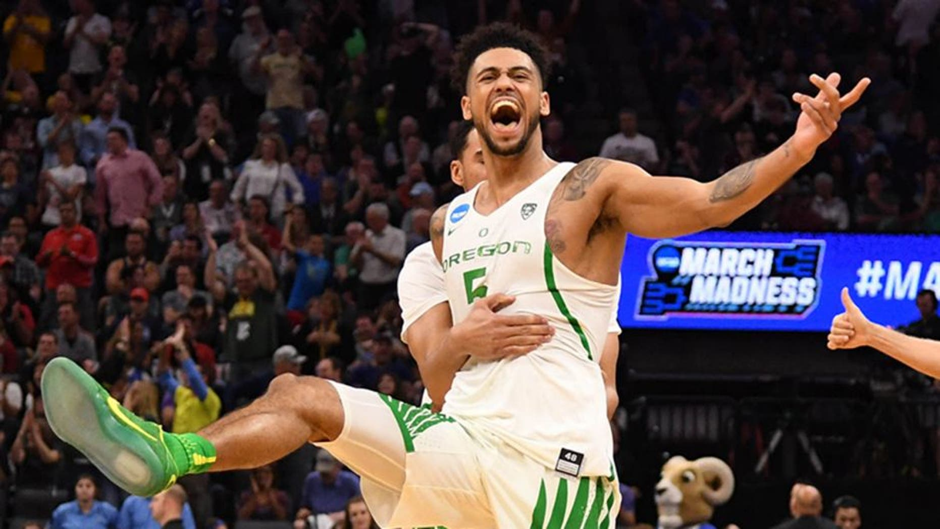 Mar 19, 2017; Sacramento, CA, USA; Oregon Ducks guard Tyler Dorsey (5) celebrates with teammates after the win against Rhode Island Rams during the second round of the 2017 NCAA Tournament at Golden 1 Center. Mandatory Credit: Kyle Terada-USA TODAY Sports