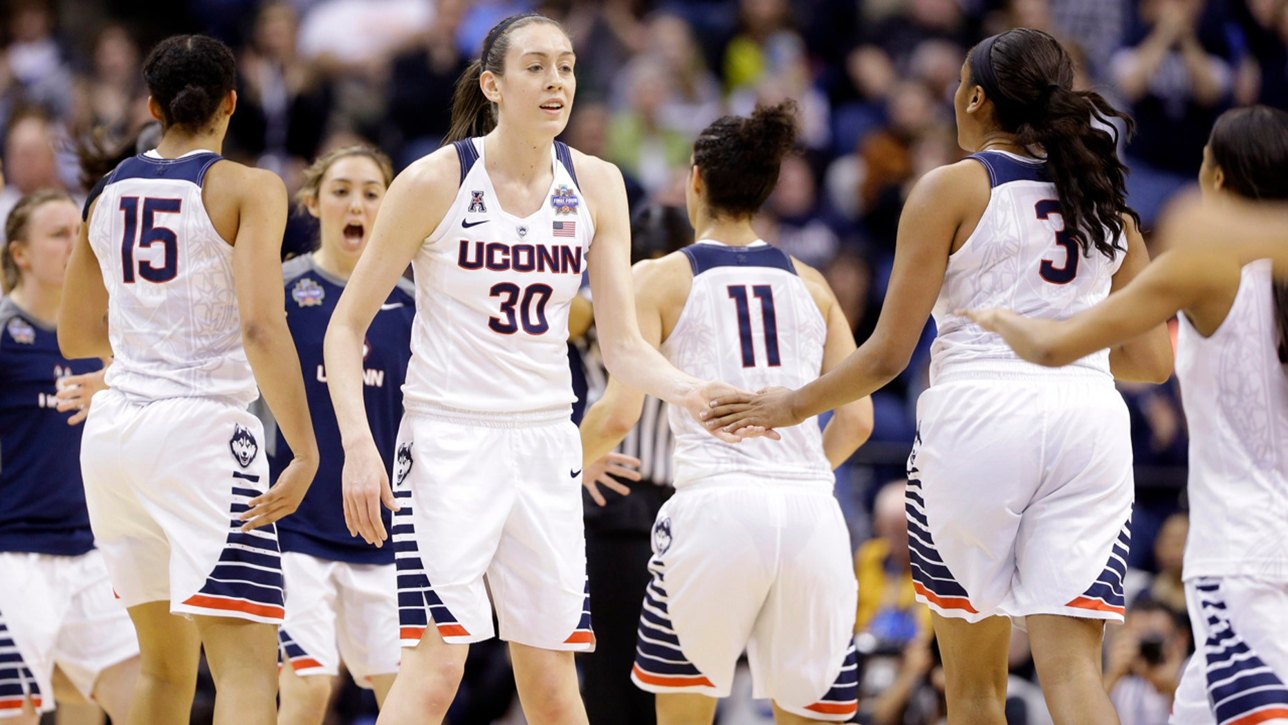 April 5, 2016: Connecticut's Breanna Stewart (30) greets teammates during a timeout during the first half of the NCAA women's basketball championship game against Syracuse in Indianapolis.