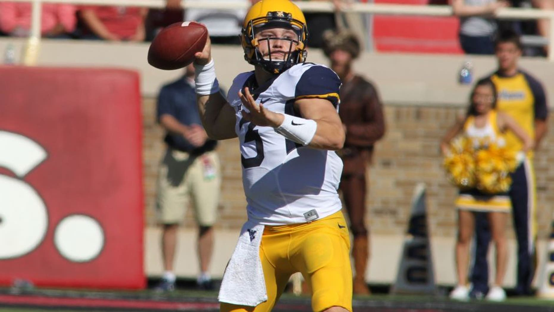 Oct 15, 2016; Lubbock, TX, USA; West Virginia Mountaineers quarterback Skyler Howard (3) prepares to make a throw against the Texas Tech Red Raiders in the first half at Jones AT&T Stadium. Mandatory Credit: Michael C. Johnson-USA TODAY Sports
