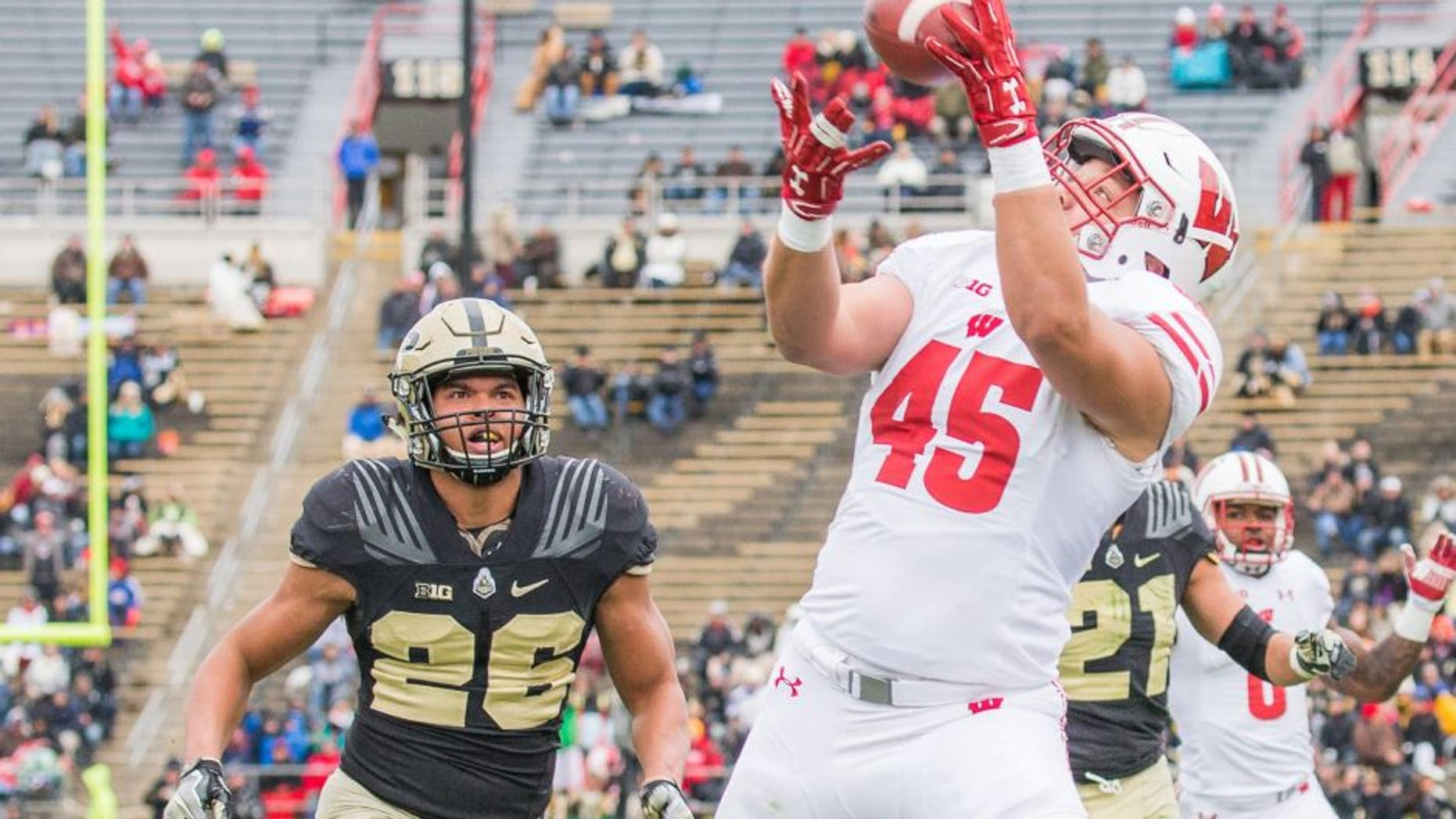 Nov 19, 2016; West Lafayette, IN, USA; Wisconsin Badgers fullback Alec Ingold (45) scores a touchdown while Purdue Boilermakers safety C.J. Parker (26) defends in the second quarter of the game at Ross Ade Stadium. Mandatory Credit: Trevor Ruszkowski-USA TODAY Sports