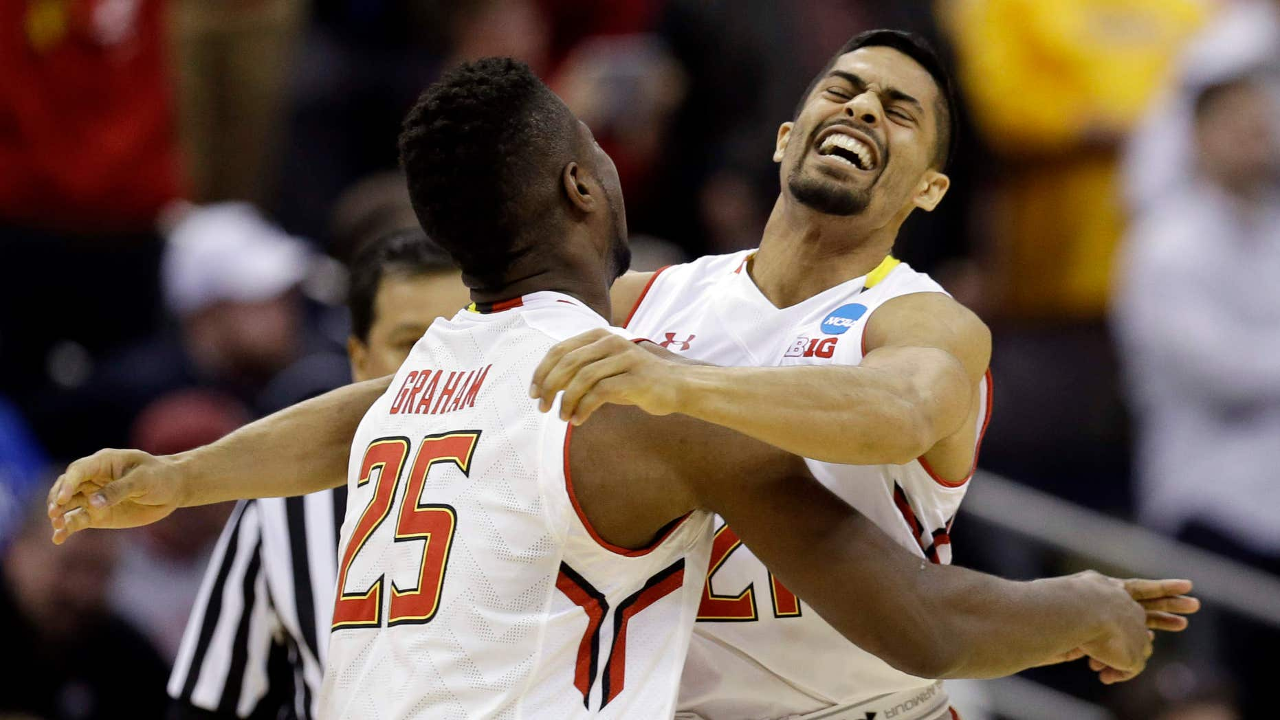 March 20, 2015: Maryland's Jonathan Graham (25) and Varun Ram celebrate after a 65-62 win over Valparaiso in an NCAA tournament college basketball game in the Round of 64 in Columbus, Ohio.