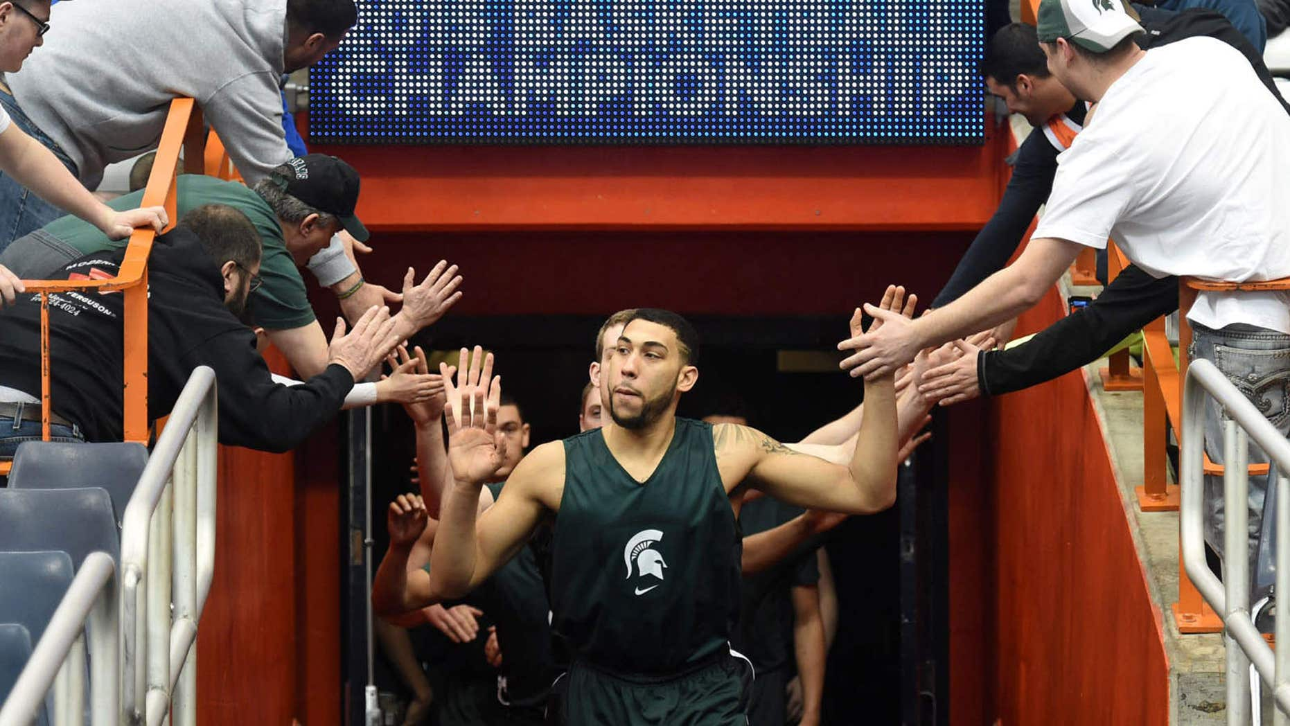 March 26, 2015: The Michigan State basketball team enters the Carrier Dome before practice for an east regional semifinal in the NCAA Tournament.