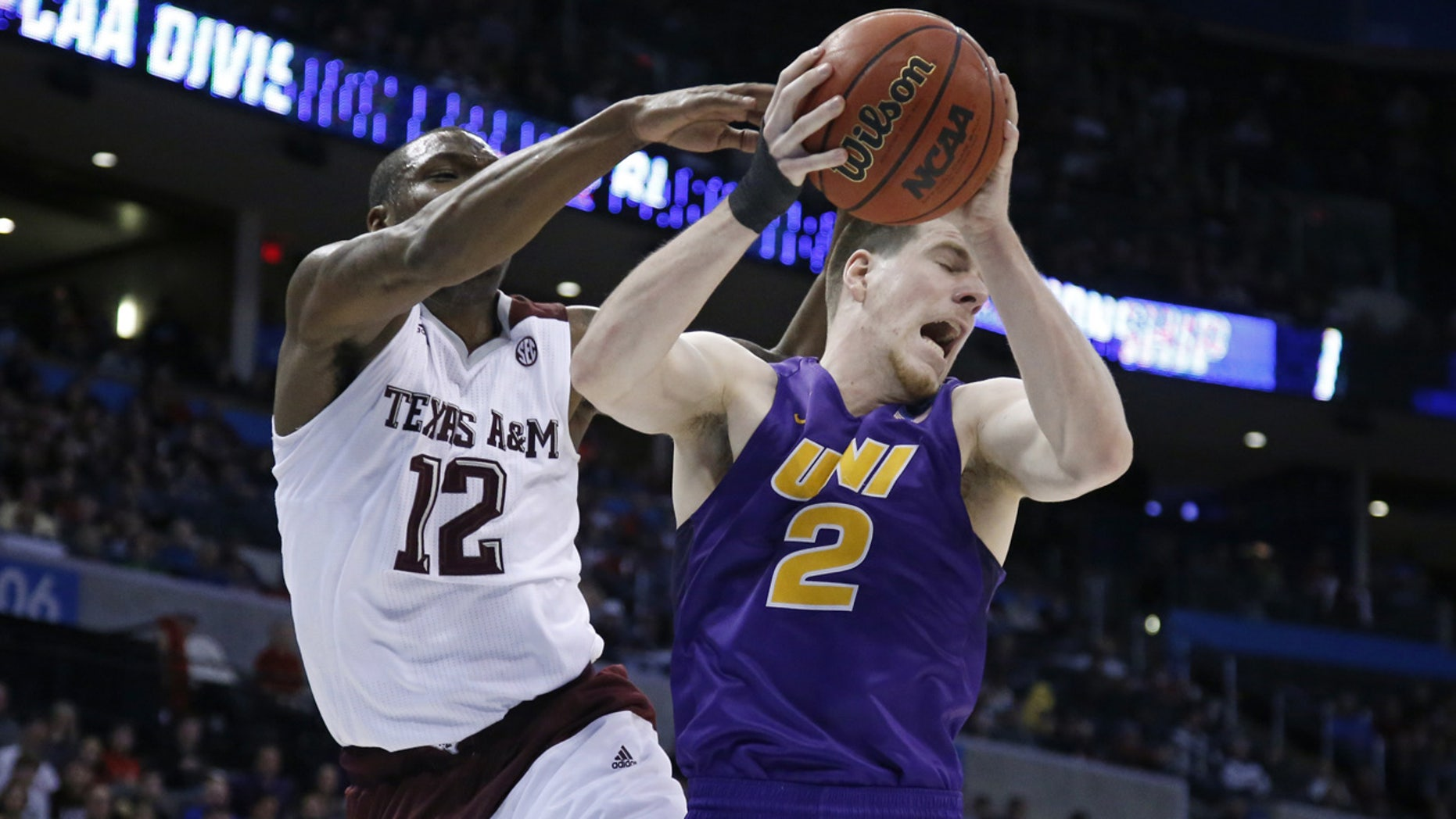 March 20, 2016: Northern Iowa forward Klint Carlson (2) grabs a rebound in front of Texas A&M guard Jalen Jones (12) in the first half of a second-round men's college basketball game in the NCAA Tournament in Oklahoma City (AP Photo/Sue Ogrocki)
