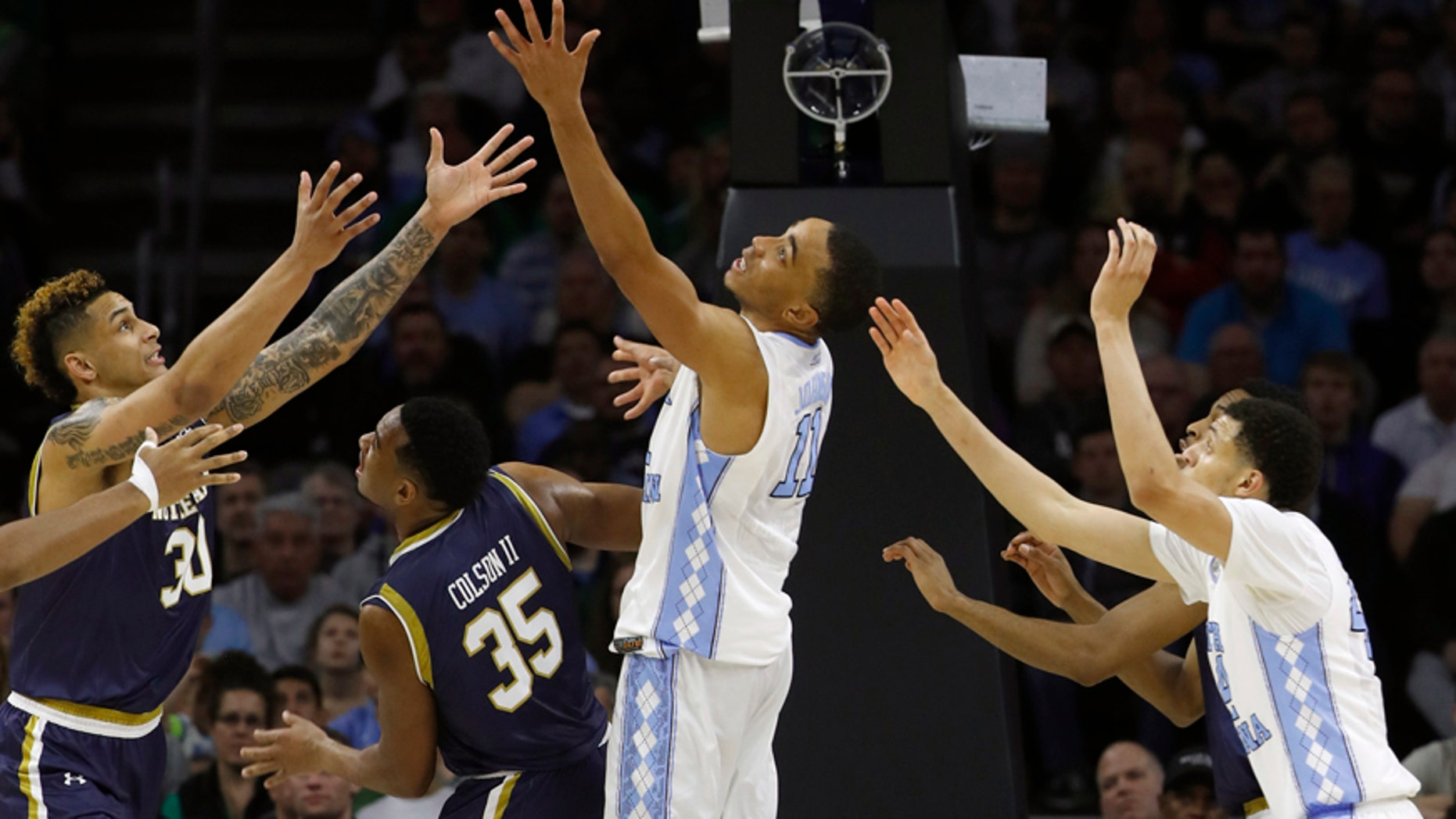 March 27, 2016: Notre Dame's Zach Auguste, far left, Bonzie Colson and North Carolina's Brice Johnson and Justin Jackson chase a rebound during the second half of the East Regional final in the men's NCAA basketball tournament in Philadelphia.