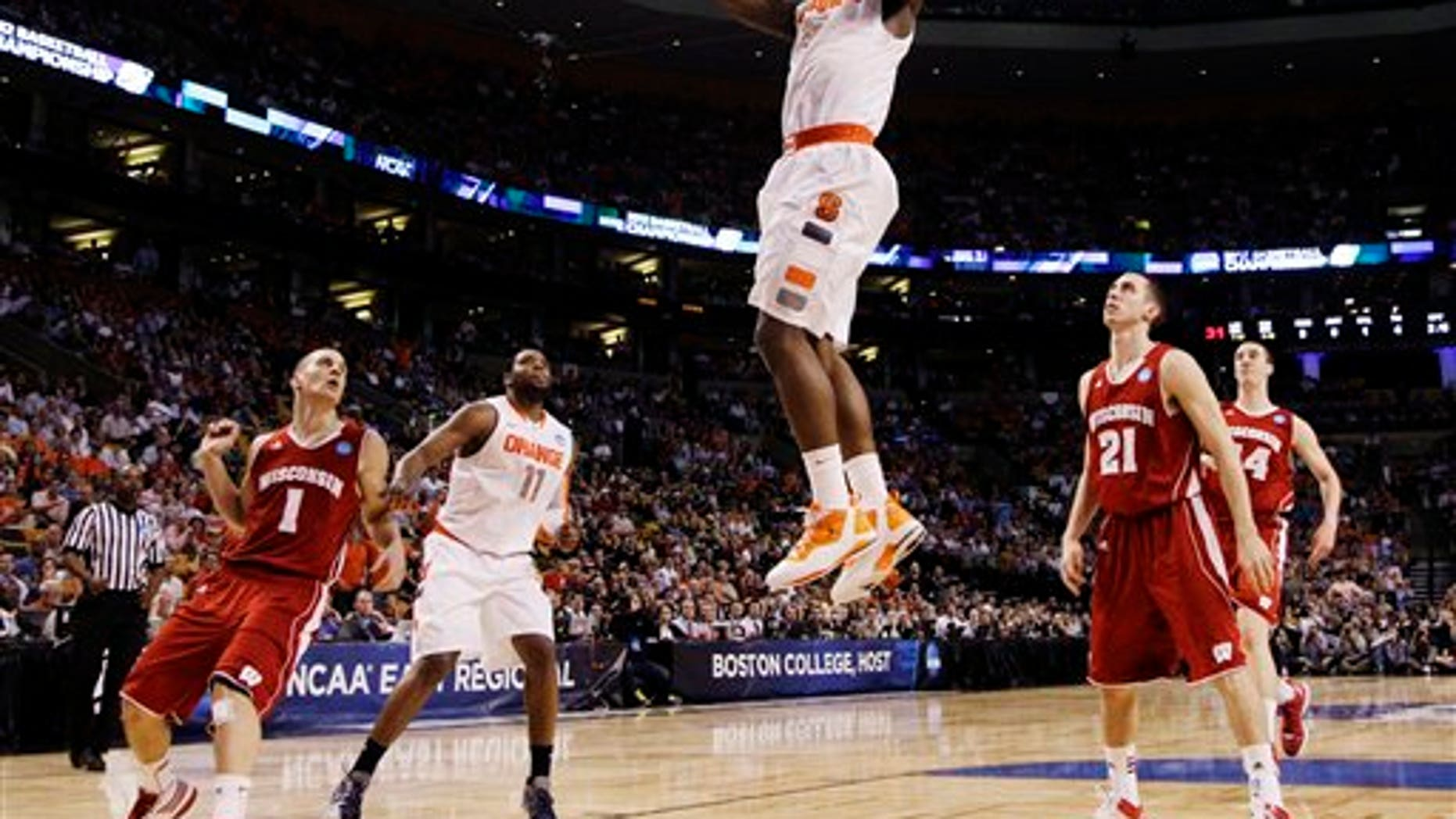 March 22, 2012: Syracuse forward C.J. Fair (5) dunks in front of Wisconsin guards Ben Brust (1) and Josh Gasser (21) in the first half of an East Regional semifinal game in the NCAA men's college basketball tournament, Thursday in Boston.