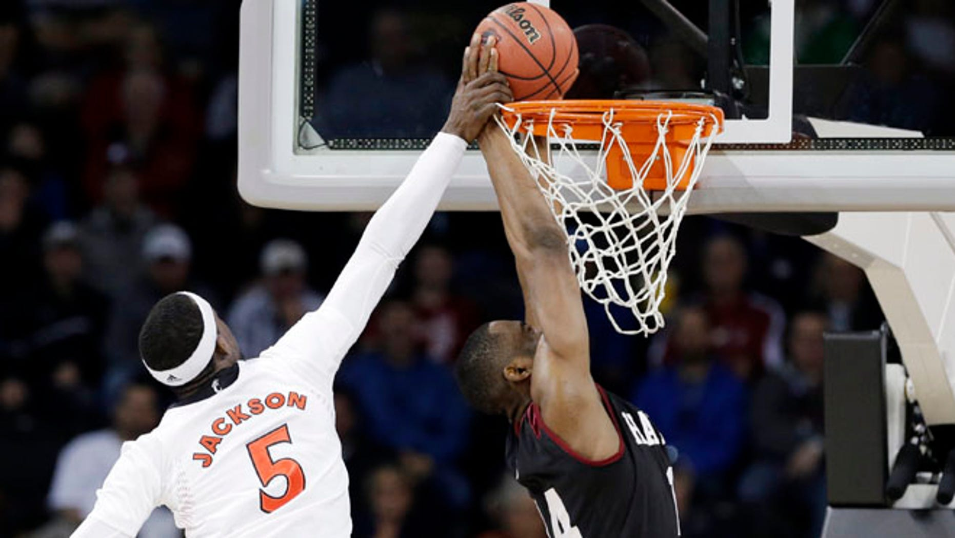 Mar. 20, 2014: Cincinnati's Justin Jackson (5) tries to stop a shot by Harvard's Steve Moundou-Missi in the first half during a second-round game of the NCAA college basketball tournament in Spokane, Wash.
