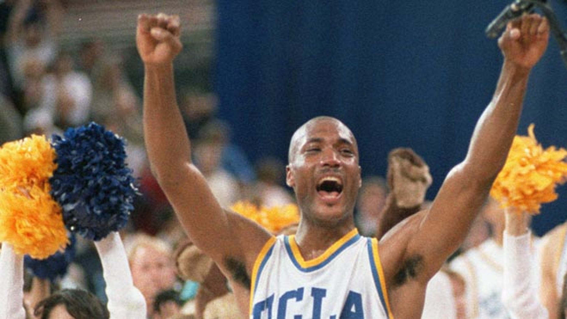 April 3, 1995: UCLA's Ed O'Bannon celebrates after his team won the  championship NCAA game against Arkansas in Seattle.