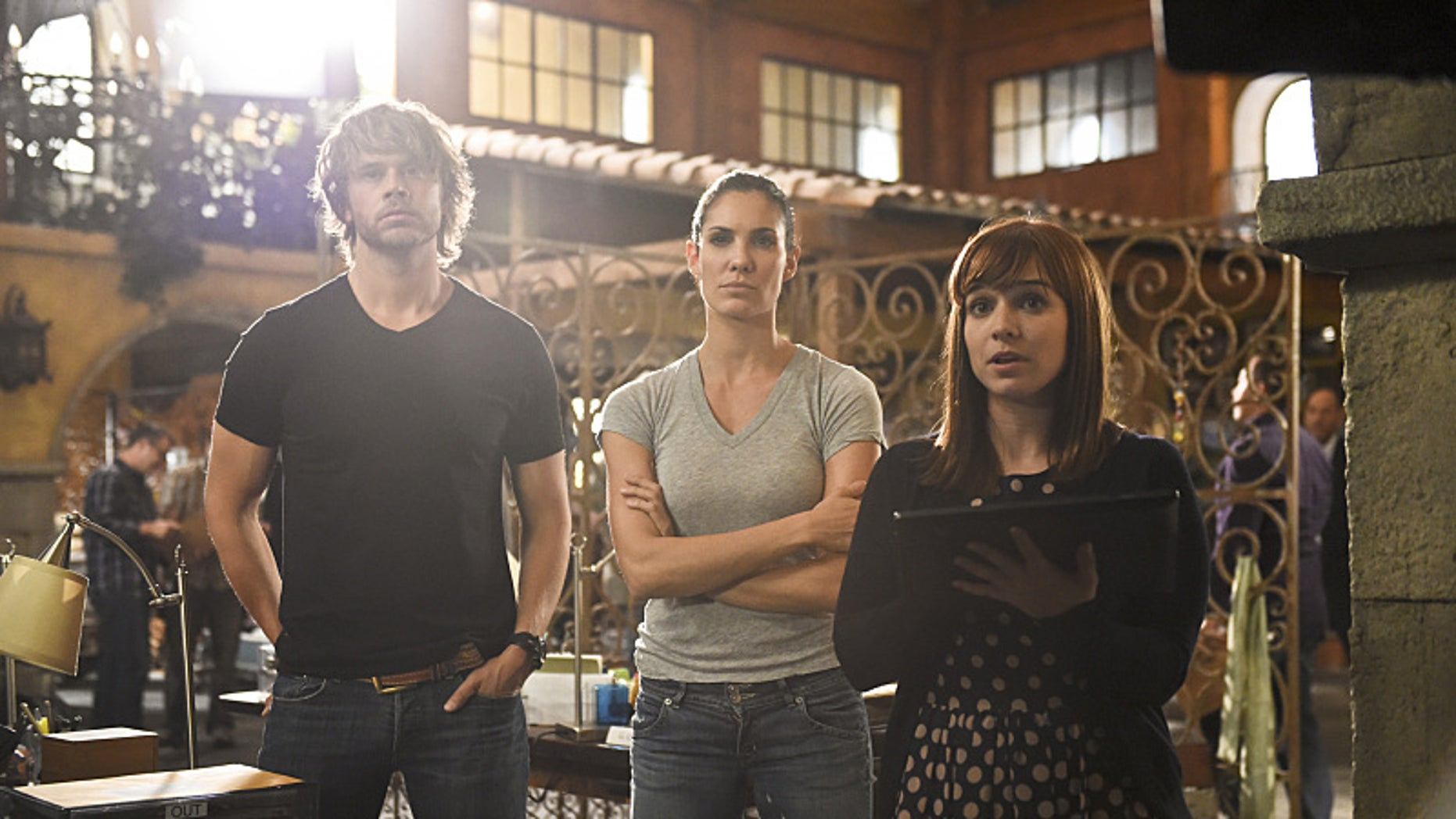 """""""Inelegant Heart"""" -- Pictured: Eric Christian Olsen (LAPD Liaison Marty Deeks), Daniela Ruah (Special Agent Kensi Blye) and Renée Felice Smith (Intelligence Analyst Nell Jones). The NCIS: LA team discovers that one of their own is compromised when they investigate the murder of a Navy contractor involved in illegal transactions of confidential data. Meanwhile, Hetty is under investigation in Washington, D.C., when the Department of Justice arrives in L.A. to investigate the team, on NCIS: LOS ANGELES, Monday, Oct. 6 (9:59-11:00, ET/PT), on the CBS Television Network Photo: Ron P. Jaffe/CBS ©2014 CBS Broadcasting, Inc. All Rights Reserved."""