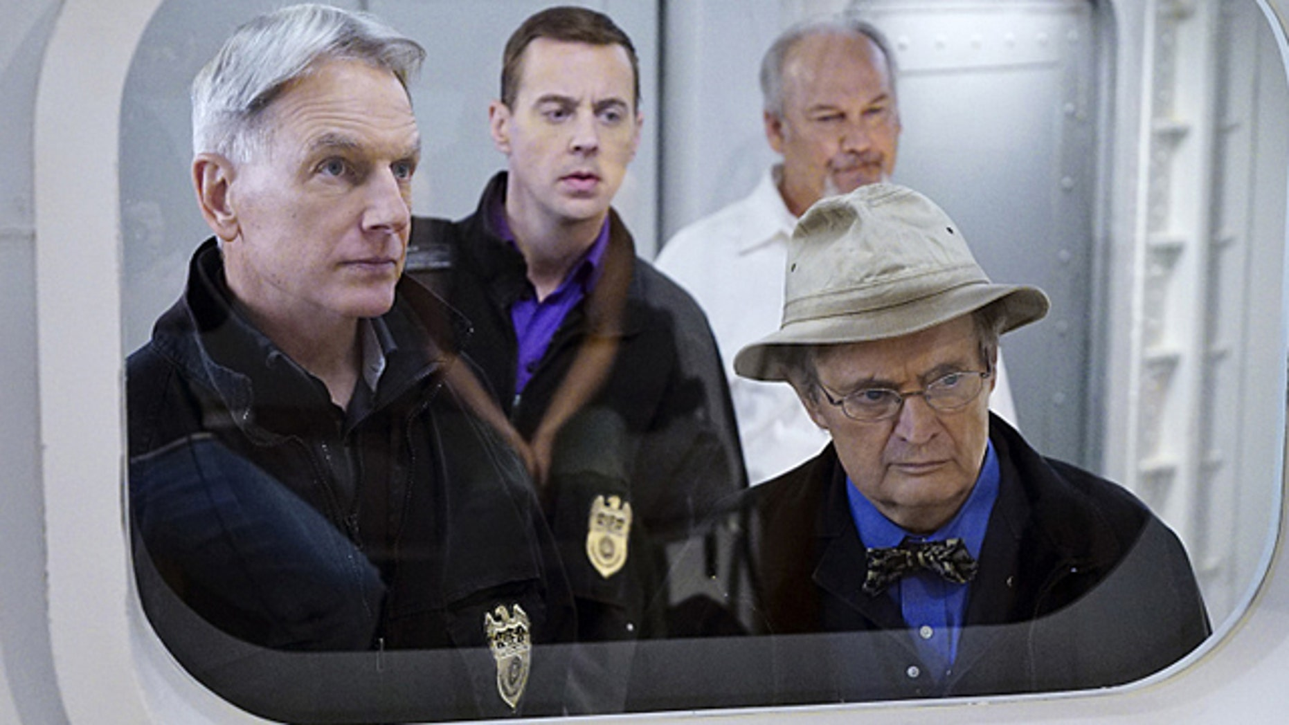 'Decompressed' -- When a deep sea diver is murdered on the job, his body and suspected co-workers must remain in a high-tech decompression chamber for four days, leaving the NCIS team to complete an unorthodox investigation from outside the tank. Pictured left to right: Mark Harmon, Sean Murray, Brett Rice and David McCallum (Sonja Flemming/CBS)
