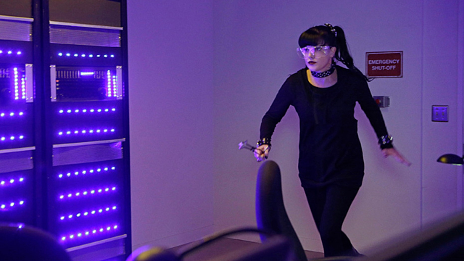 Oct. 20, 2015: While visiting a pharmaceutical lab on a murder case, Abby (Pauley Perrette) is trapped with no communication to the outside world after armed men take over the building and hold everyone hostage, on 'NCIS.' (Sonja Flemming/CBS)
