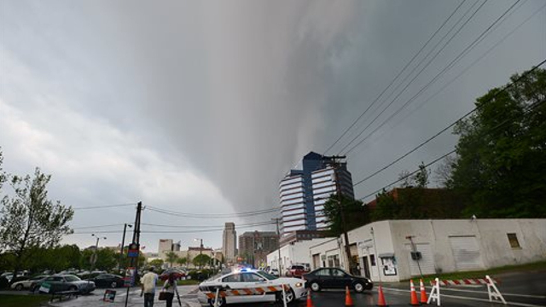 April 25, 2014: Menacing dark clouds brought rain, wind and lightning above downtown Durham North Carolina, as cold and warm fronts clashed, making a dangerous weather situation.