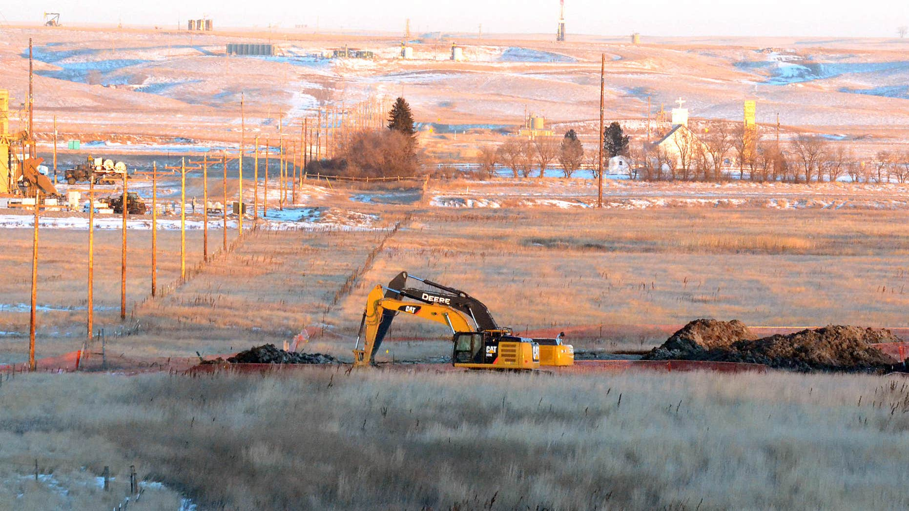 Jan. 12, 2015: Crews dig up land at a saltwater spill site near Blacktail Creek outside Williston, N.D.