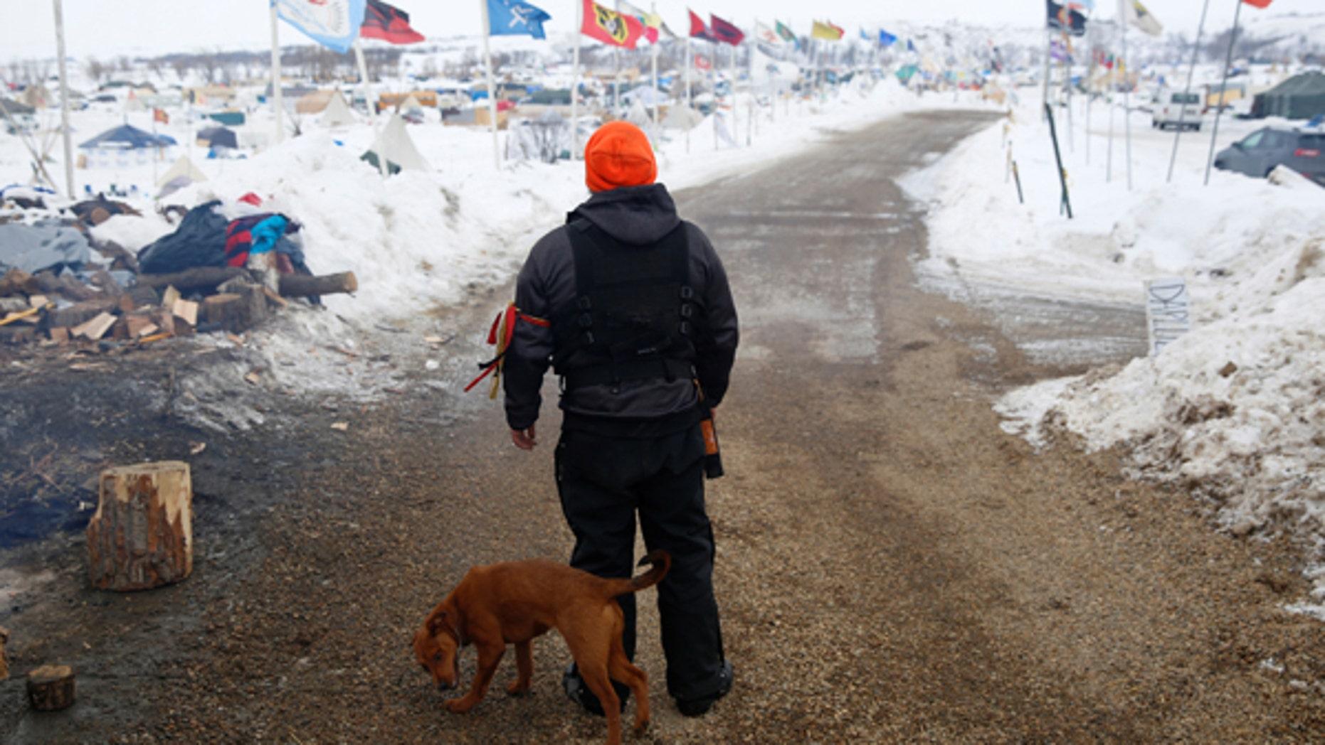 A security volunteer stands in the Dakota Access Pipeline protest camp near Cannon Ball, North Dakota, U.S., January 24, 2017.