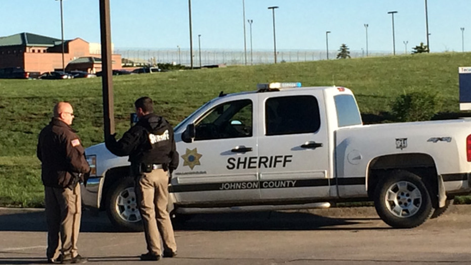 May 11, 2015: Members of the Johnson County Sheriff's Department stand outside the the Tecumseh State Correctional Institution in Tecomseh, Neb.