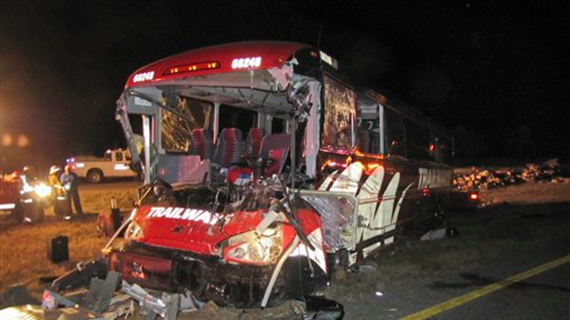 Oct. 6: This photo provided by the Nebraska State Patrol shows a Burlington Trailways bus that crashed into a semi on Interstate 80 near Gibbon, Neb. Five people were treated at hospital after the Denver-bound bus rammed into an overturned semitrailer on Interstate 80 near Gibbon, Neb., early Thursday.