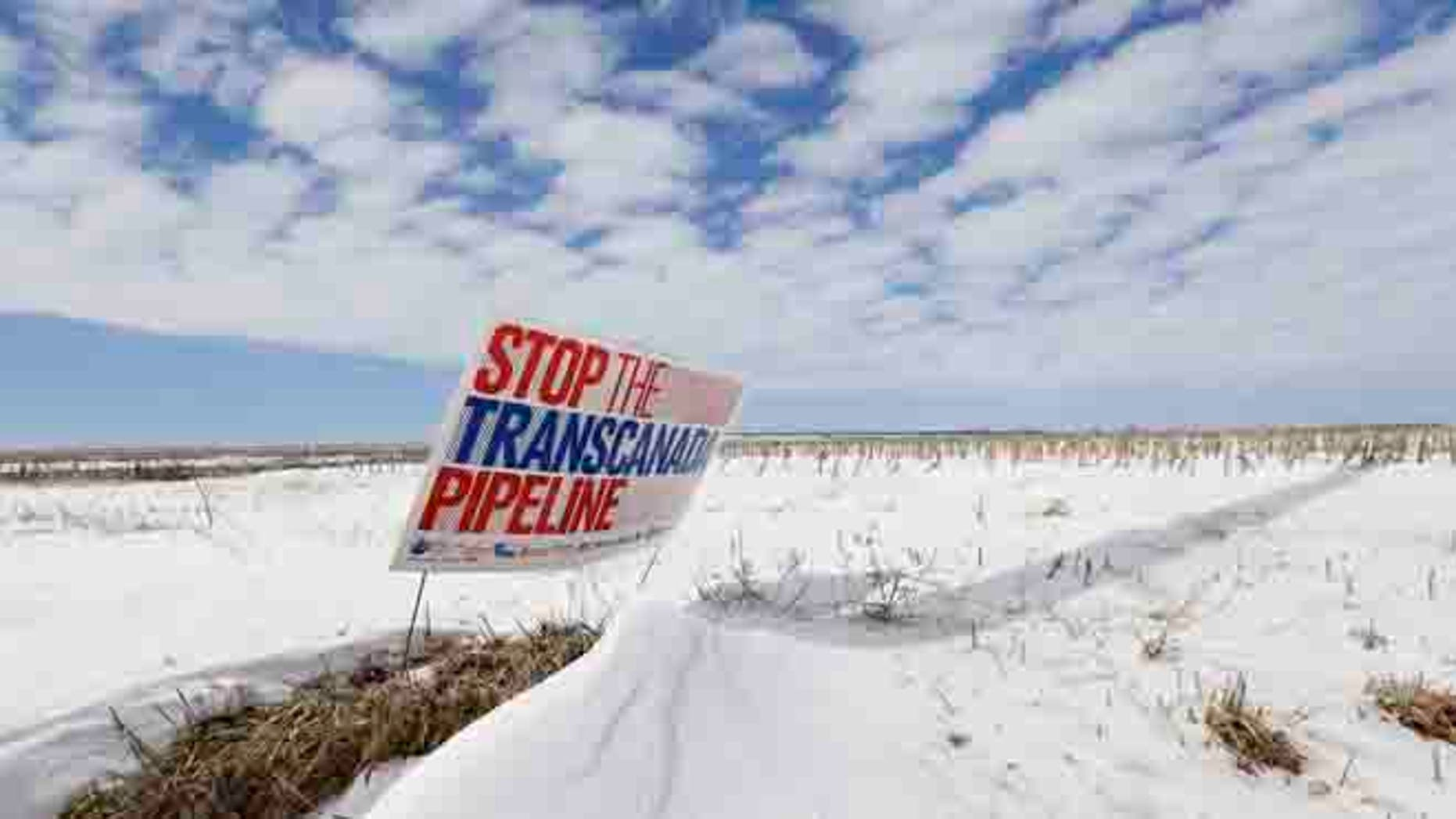 """March 11, 2013 In thisphoto, a sign reading """"Stop the Transcanada Pipeline"""" stands in a field near Bradshaw, Neb., along the Keystone XL pipeline route through the state."""