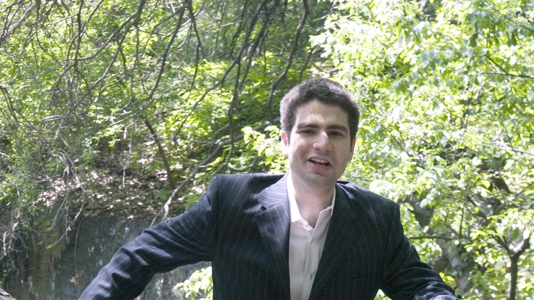May 17, 2006. Author Ned Vizzini poses for a photo in New York's Central Park. Vizzini, a popular young adult author and television writer who wrote candidly and humorously about his struggles with depression, has committed suicide. He was 32.