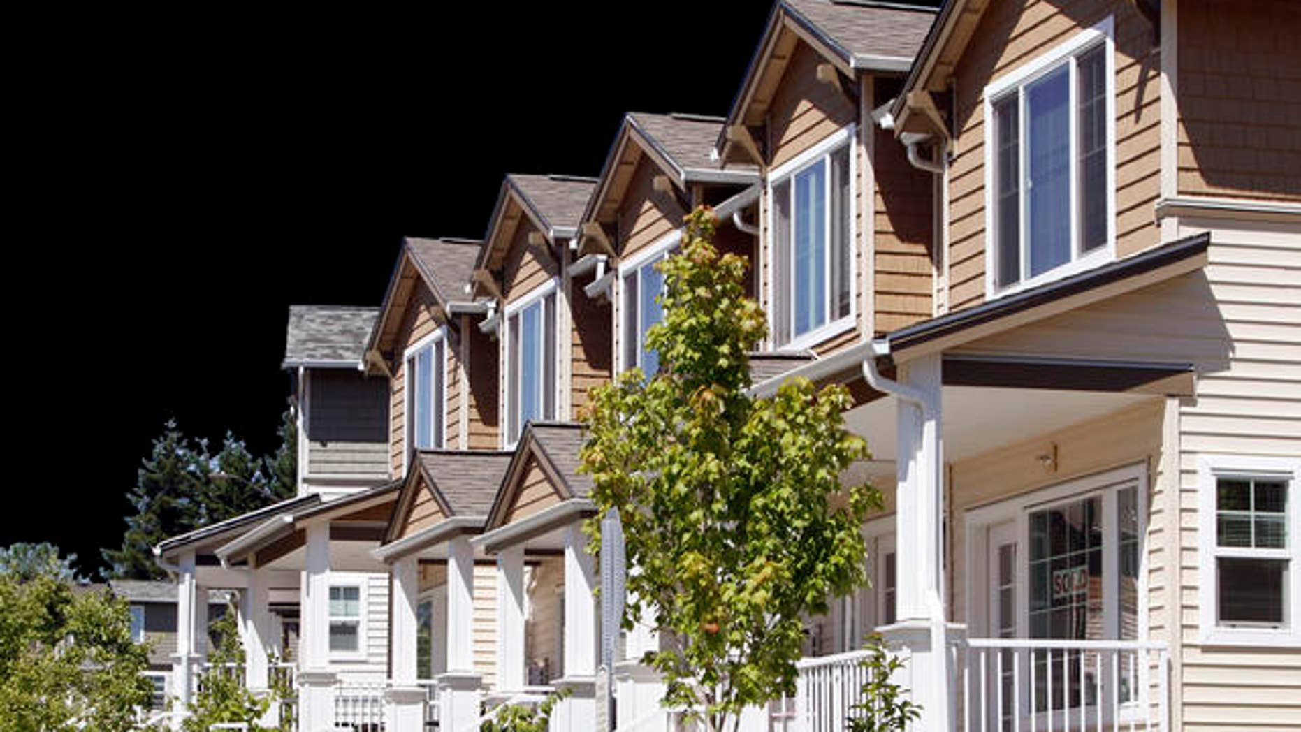 New townhouses for sale are shown in Beaverton, Ore., Monday, July 26, 2010. Home prices rose in May for the second straight month as federal tax incentives pulled more buyers into the market. .(AP Photo/Don Ryan)