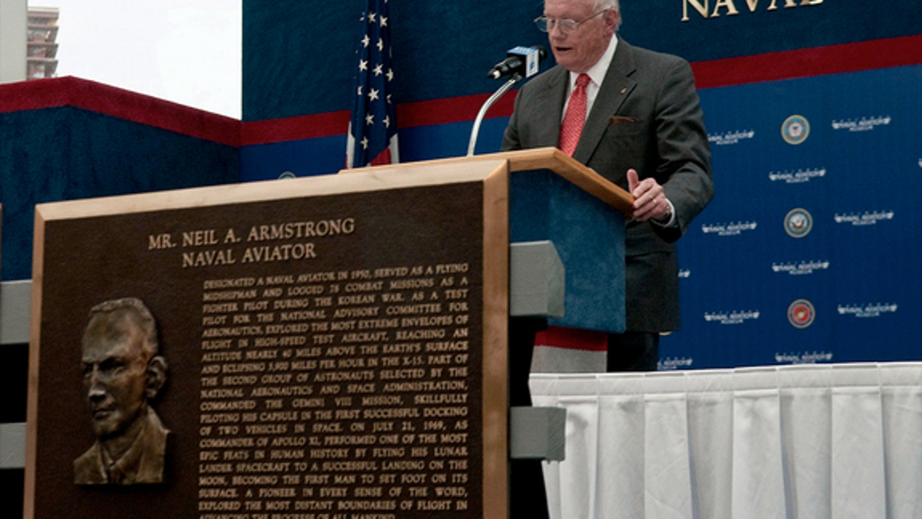 Neil Armstrong gives an acceptance speech after being inducted in 2010 into the Naval Aviation Hall of Honor at the National Naval Aviation Museum in Pensacola, Fla. The Navy will honor him with a burial sea.