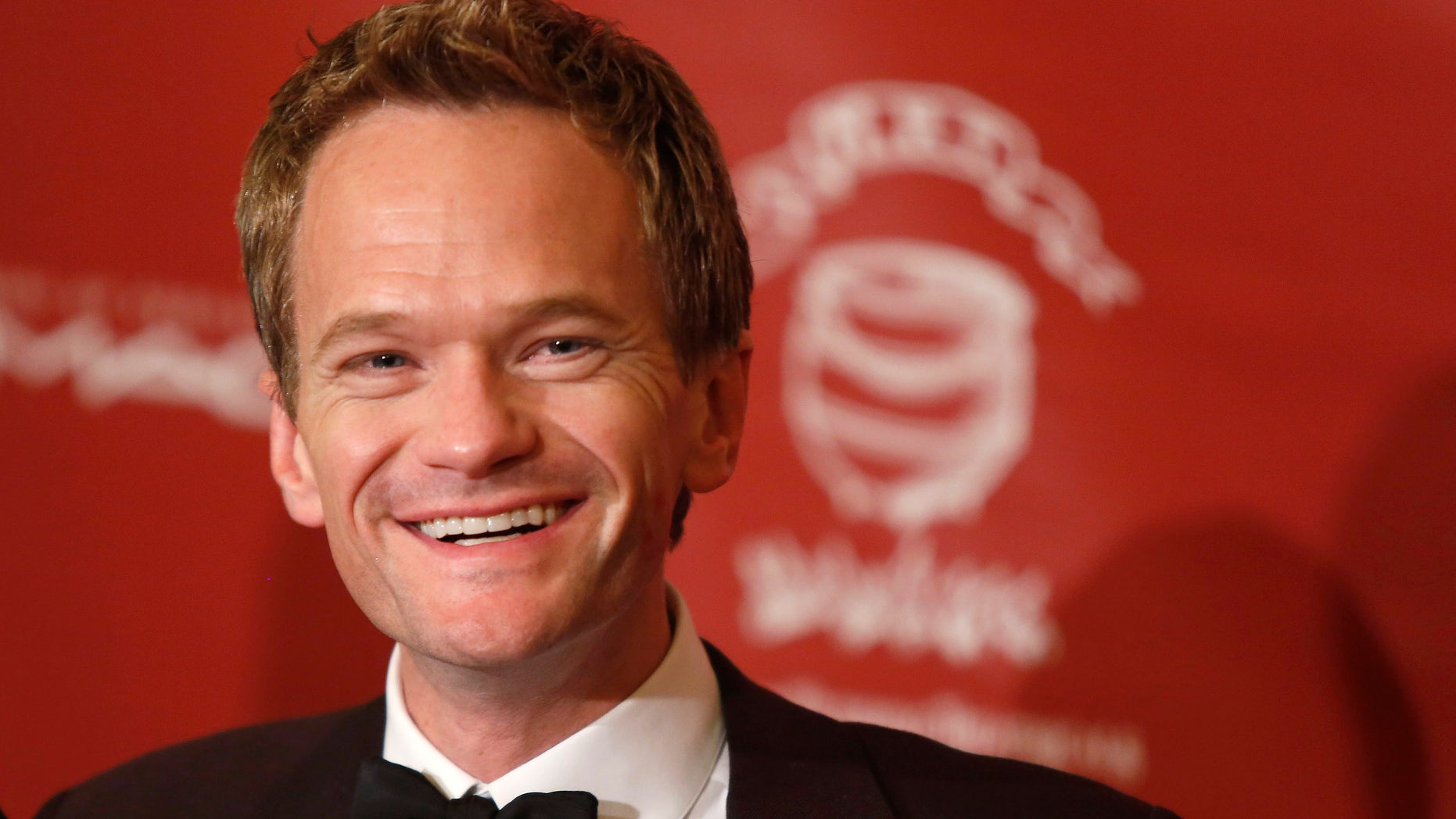 """February 7, 2014. Actor Neil Patrick Harris meets the media after he was honored as Hasty Pudding Theatricals """" Man of the Year"""" during a roast at Harvard University in Cambridge, Massachusetts."""