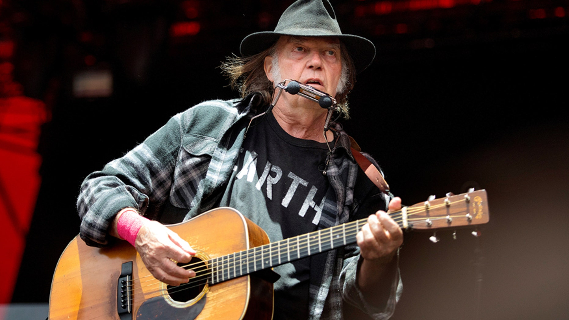 Canadian singer-songwriter Neil Young performs at the Orange Stage at the Roskilde Festival in Roskilde, Denmark, on July 1, 2016.