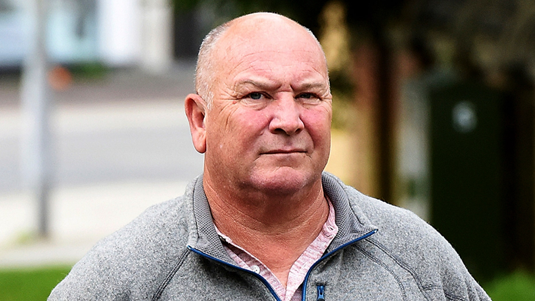 Neil Dymott, a businessman, launched a campaign of harassment against a lesbian couple living next door, a court in England heard this week.