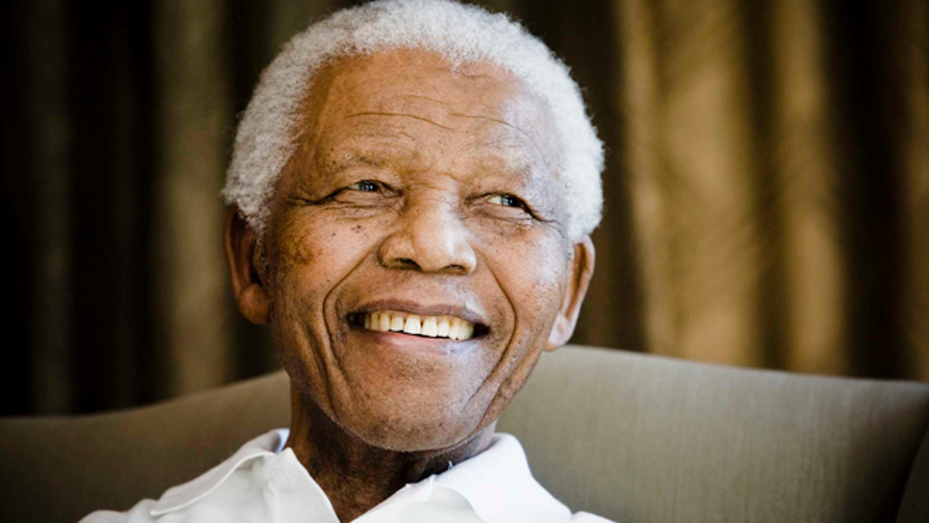 June 2, 2009: Former South African President Nelson Mandela reacts at the Mandela foundation, in Johannesburg, South Africa, during a meeting with a group of American and South African students as part of a series of activities leading to Mandela Day on July 18th.