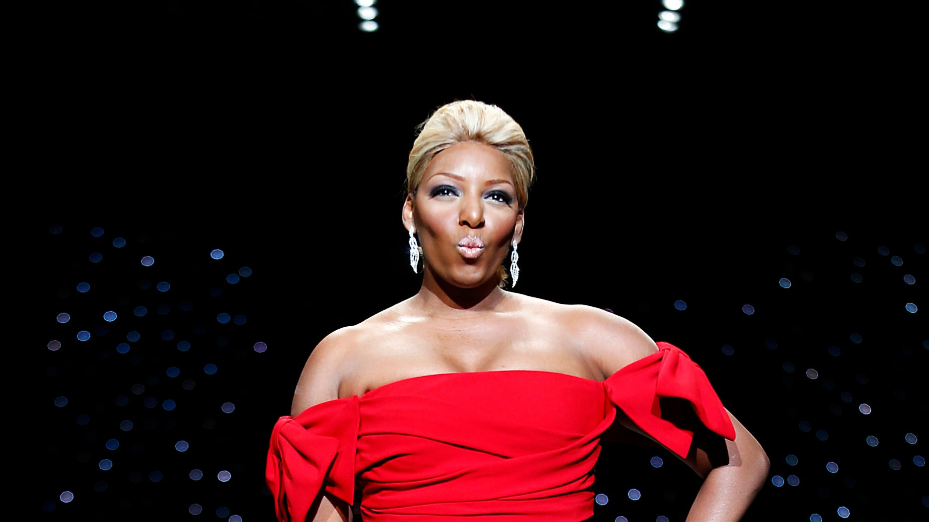 February 6, 2014. Actress Nene Leakes presents a creation by Dolce & Gabbana for the The Heart Truth Fall 2014 collection during New York Fashion Week.