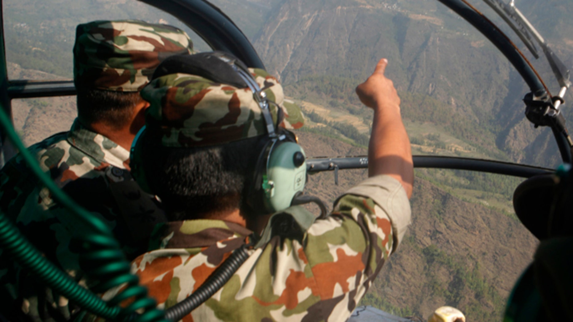 May 14, 2015: Nepalese army men search for the missing U.S. Marine helicopter in the earthquake affected Dolakha District, Nepal.