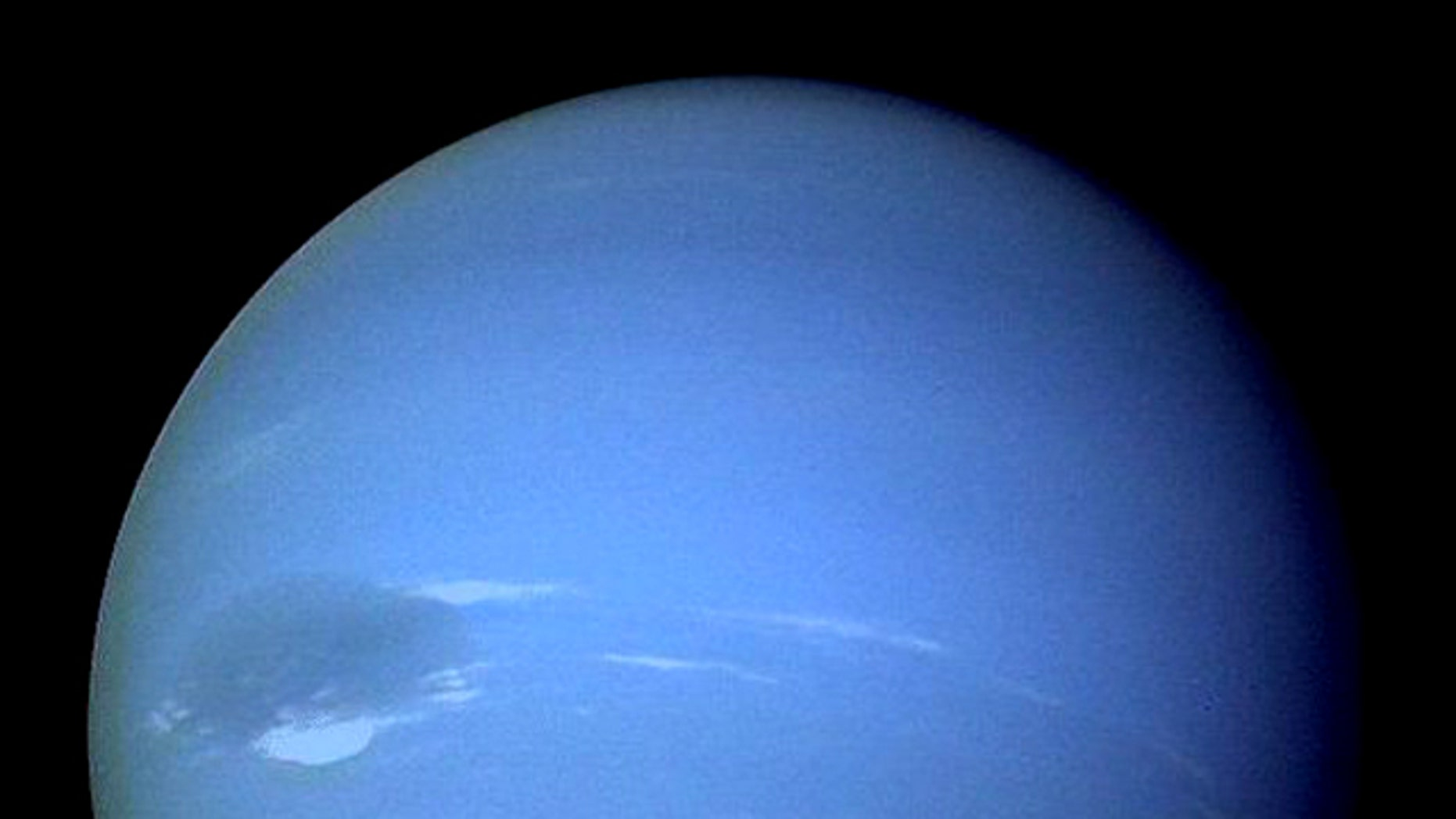 "Neptune, showing off its ""great dark spot."""