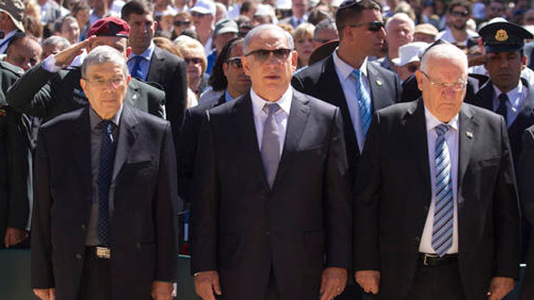 Israeli Prime Minister Benjamin Netanyahu, center, Israeli president Reuven Rivlin, right, and Chairman of the Yad Vashem Avner Shalev stand during a sirens as part of a ceremony marking the annual Holocaust Remembrance Day at the Yad Vashem Holocaust memorial, in Jerusalem, Thursday, May 5, 2016. (AP Photo/Dan Balilty)